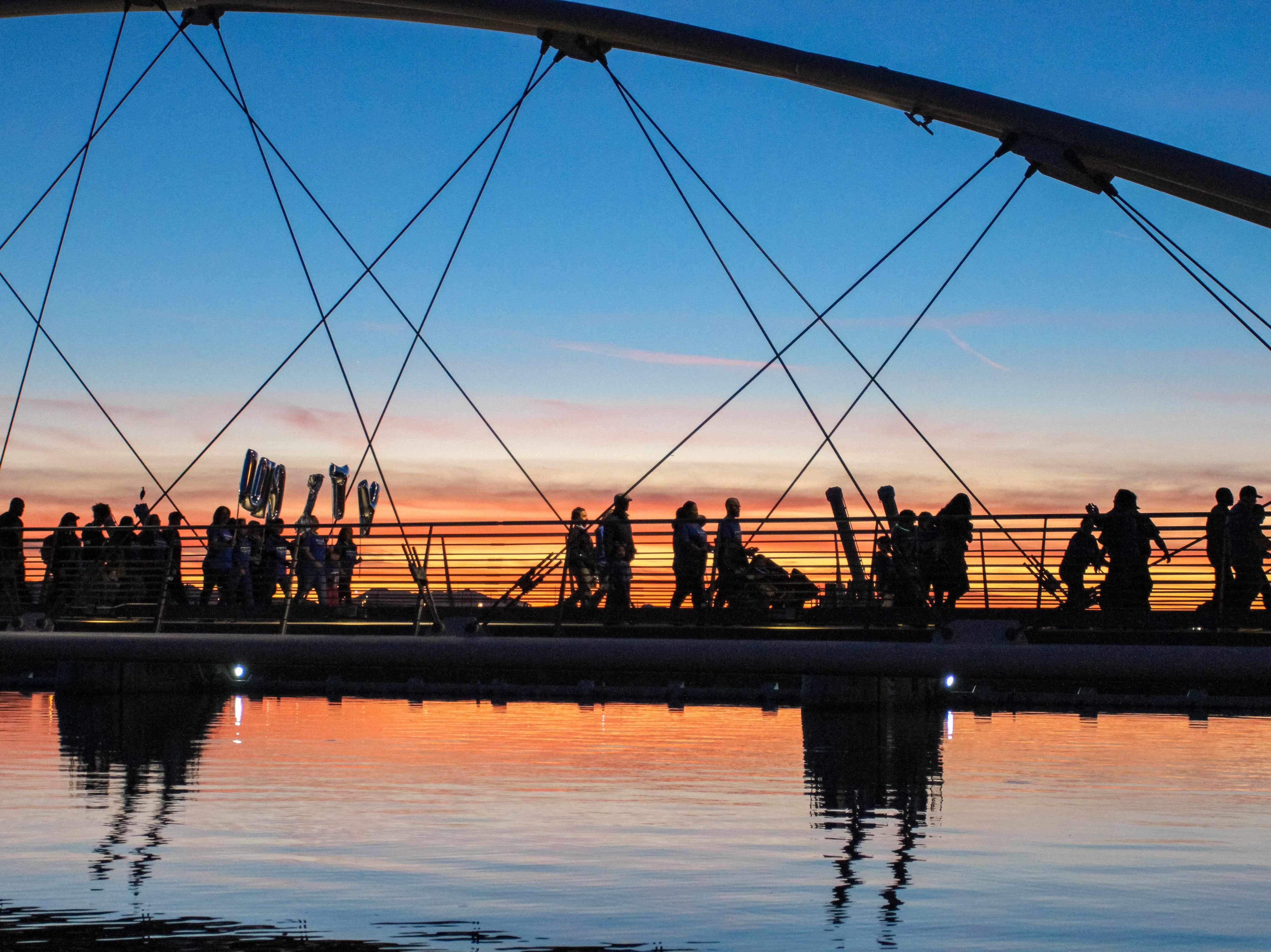 Participants walk over the Elmore Pedestrian Bridge at the Unity Walk 2019 at Tempe Beach Park, in Tempe, Arizona on Saturday, Jan. 26, 2019.