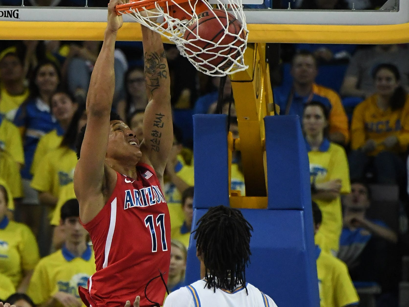Jan 26, 2019; Los Angeles, CA, USA; Arizona Wildcats forward Ira Lee (11) dunks as UCLA Bruins center Moses Brown (1) looks on in the second half at Pauley Pavilion.