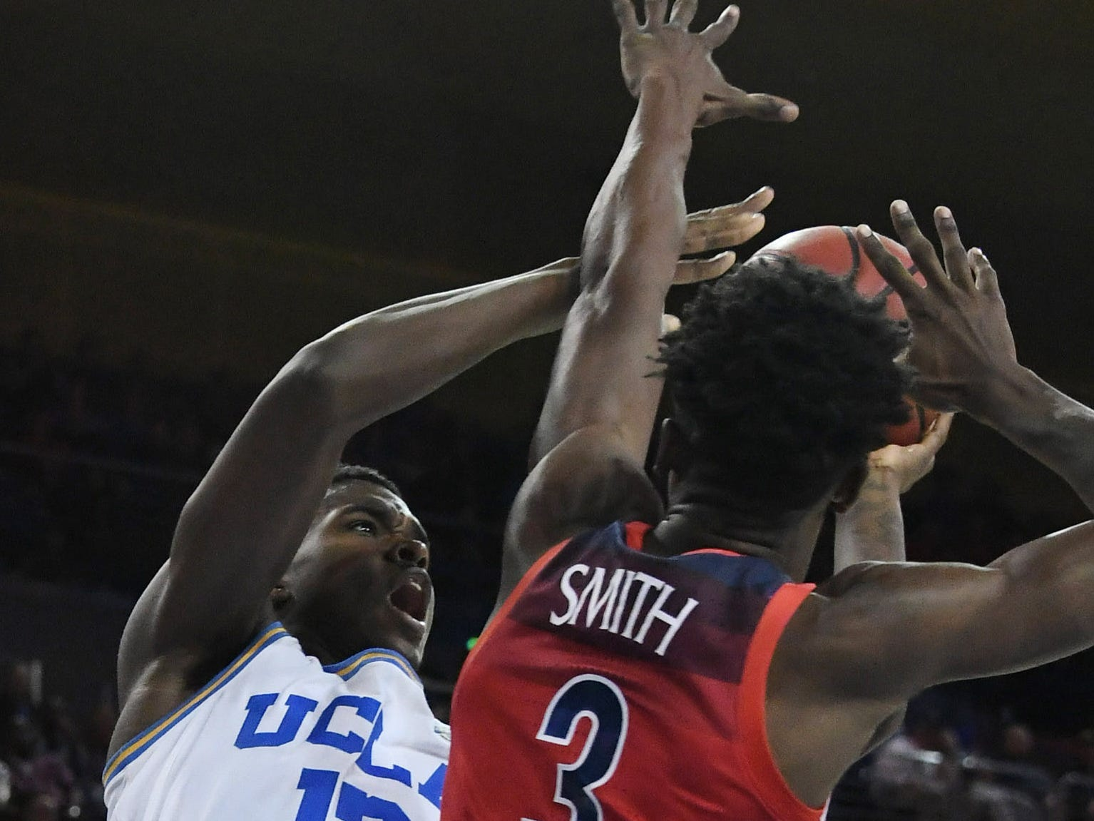 Jan 26, 2019; Los Angeles, CA, USA; UCLA Bruins guard Kris Wilkes (13) shoots against Arizona Wildcats guard Dylan Smith (3) in the second half at Pauley Pavilion.