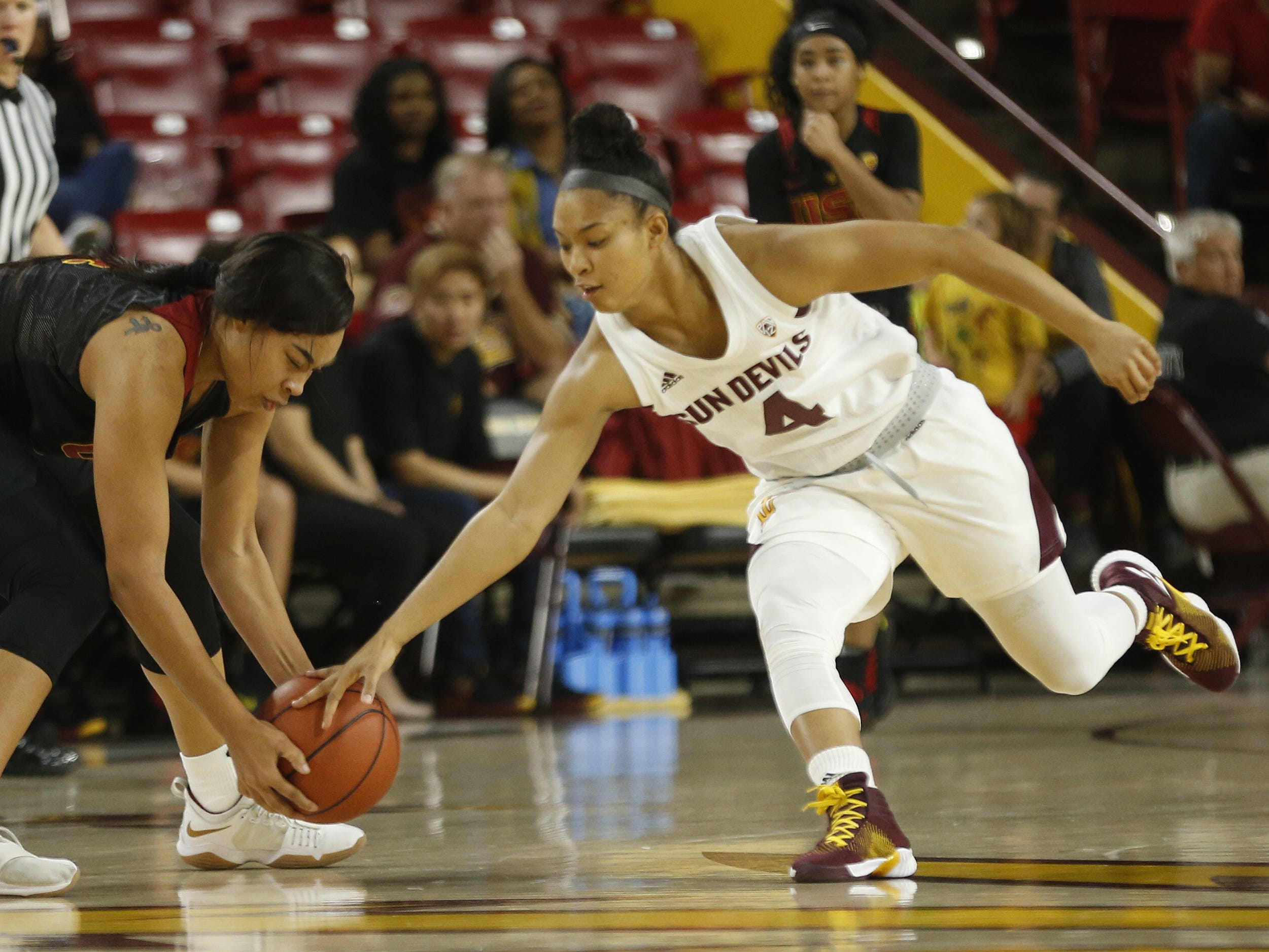 ASU's Kiara Russell (4) goes for a steal against USC's Mariya Moore (4) during the second half at Wells Fargo Arena in Tempe, Ariz. on January 27, 2019.
