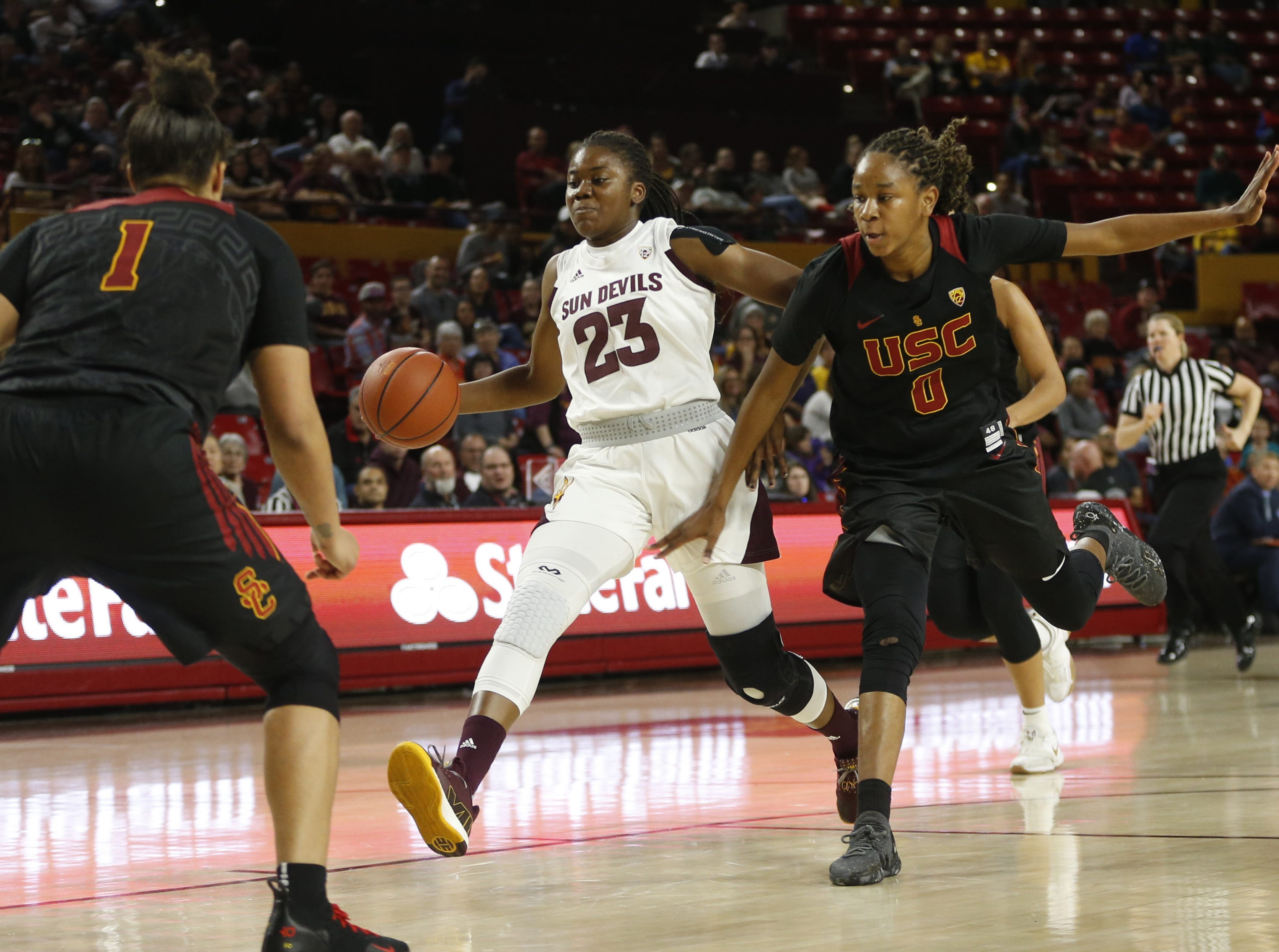 ASU's Iris Mbulito (23) draws a foul from USC's Shalexxus Aaron (0) during the second half at Wells Fargo Arena in Tempe, Ariz. on January 27, 2019.