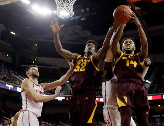 Arizona State forward Kimani Lawrence (14) grabs a rebound next to teammate De'Quon Lake (32) during the second half of an NCAA college basketball game against Southern California, Saturday, Jan. 26, 2019, in Los Angeles.