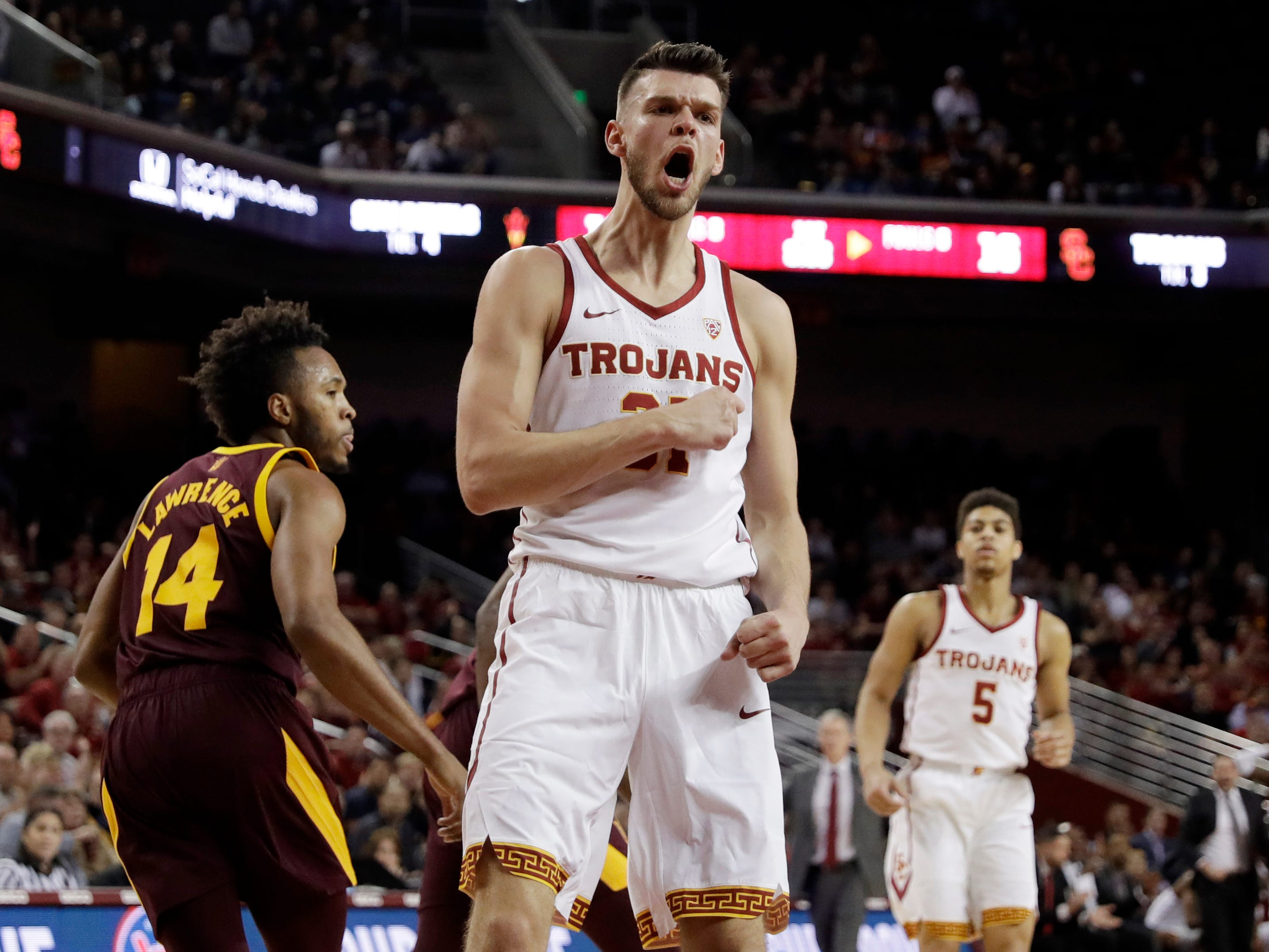 Southern California forward Nick Rakocevic, center, reacts after scoring against Arizona State during the first half of an NCAA college basketball game Saturday, Jan. 26, 2019, in Los Angeles.
