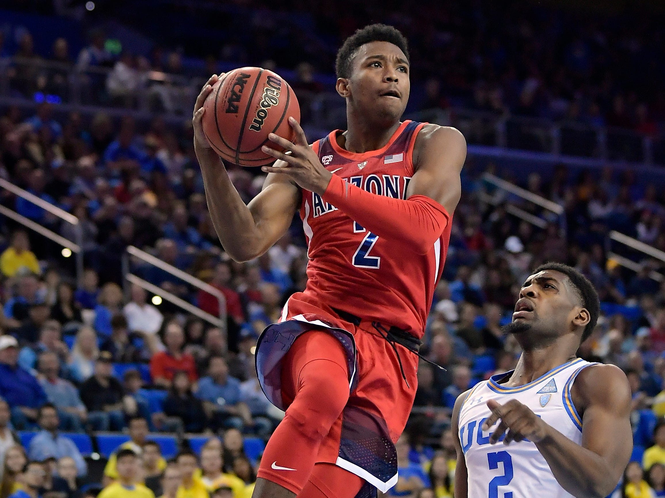 Arizona guard Brandon Williams drives as UCLA forward Cody Riley defends during the first half of an NCAA college basketball game Saturday, Jan. 26, 2019, in Los Angeles.