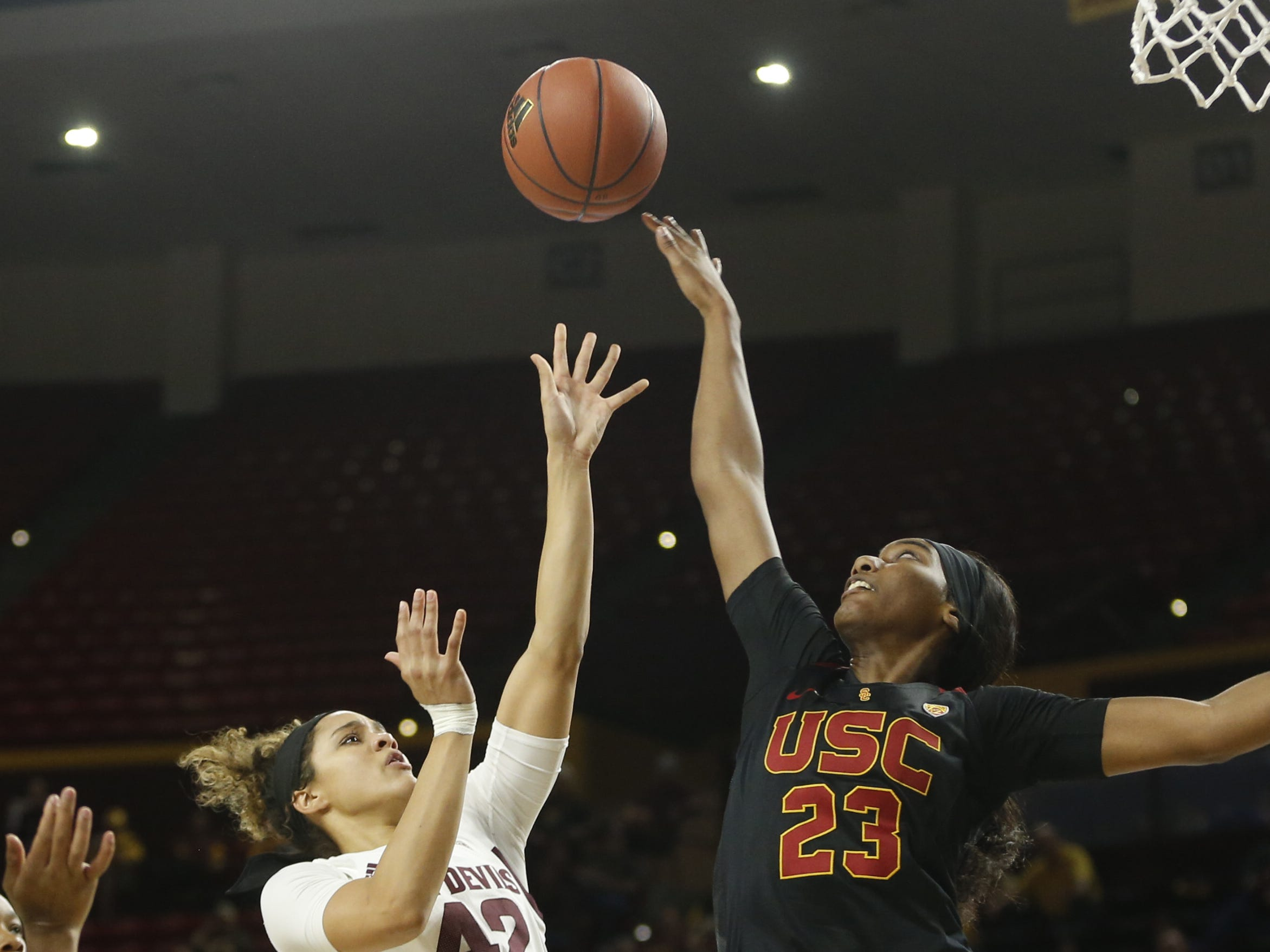 ASU's Kianna Ibis (42) shoots against USC'S Asiah Jones (23) during the first half at Wells Fargo Arena in Tempe, Ariz. on January 27, 2019.