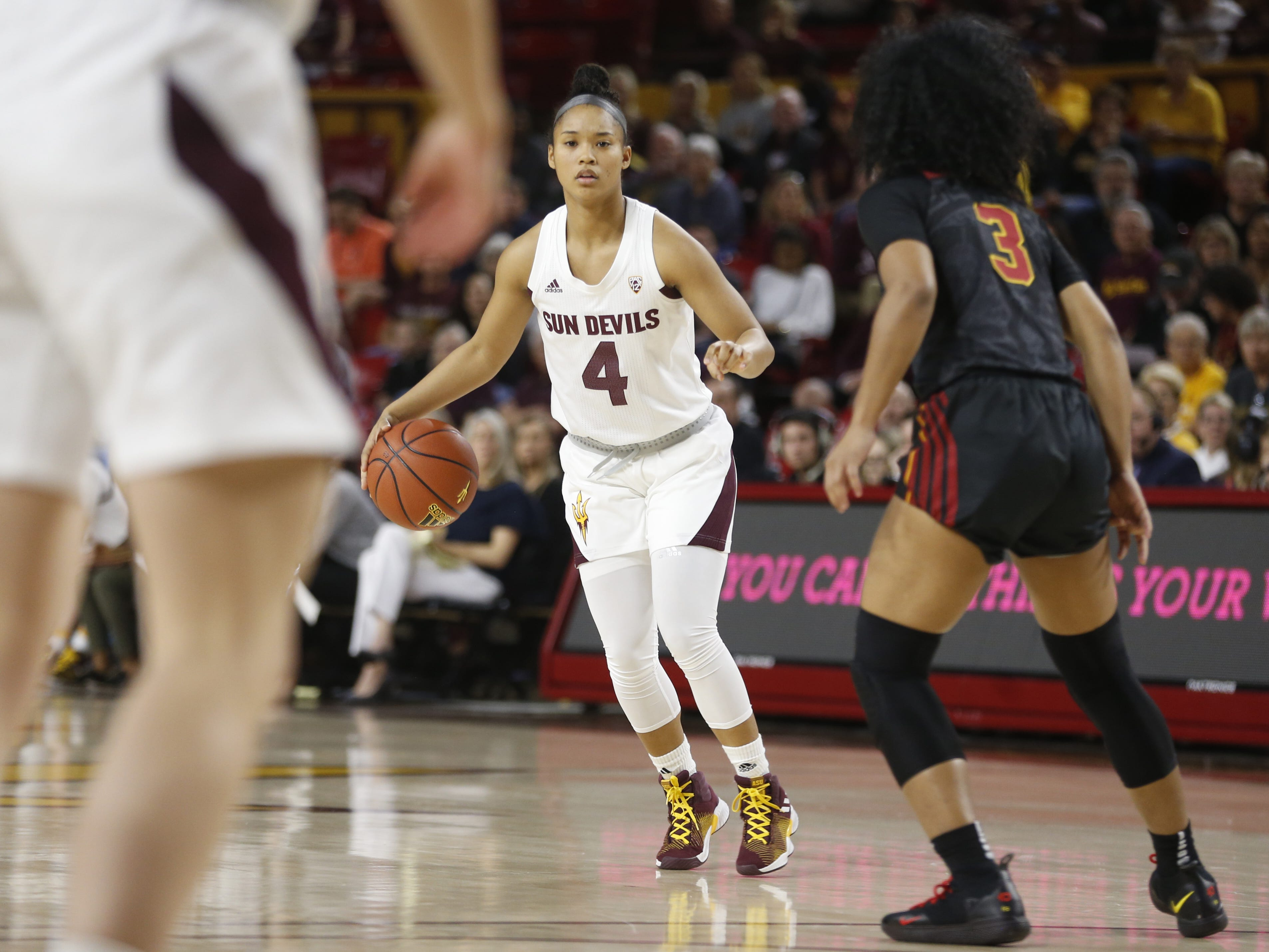 ASU's Kiara Russell (4) dribbles against USC's Minyon Moore (3) during the first half at Wells Fargo Arena in Tempe, Ariz. on January 27, 2019.