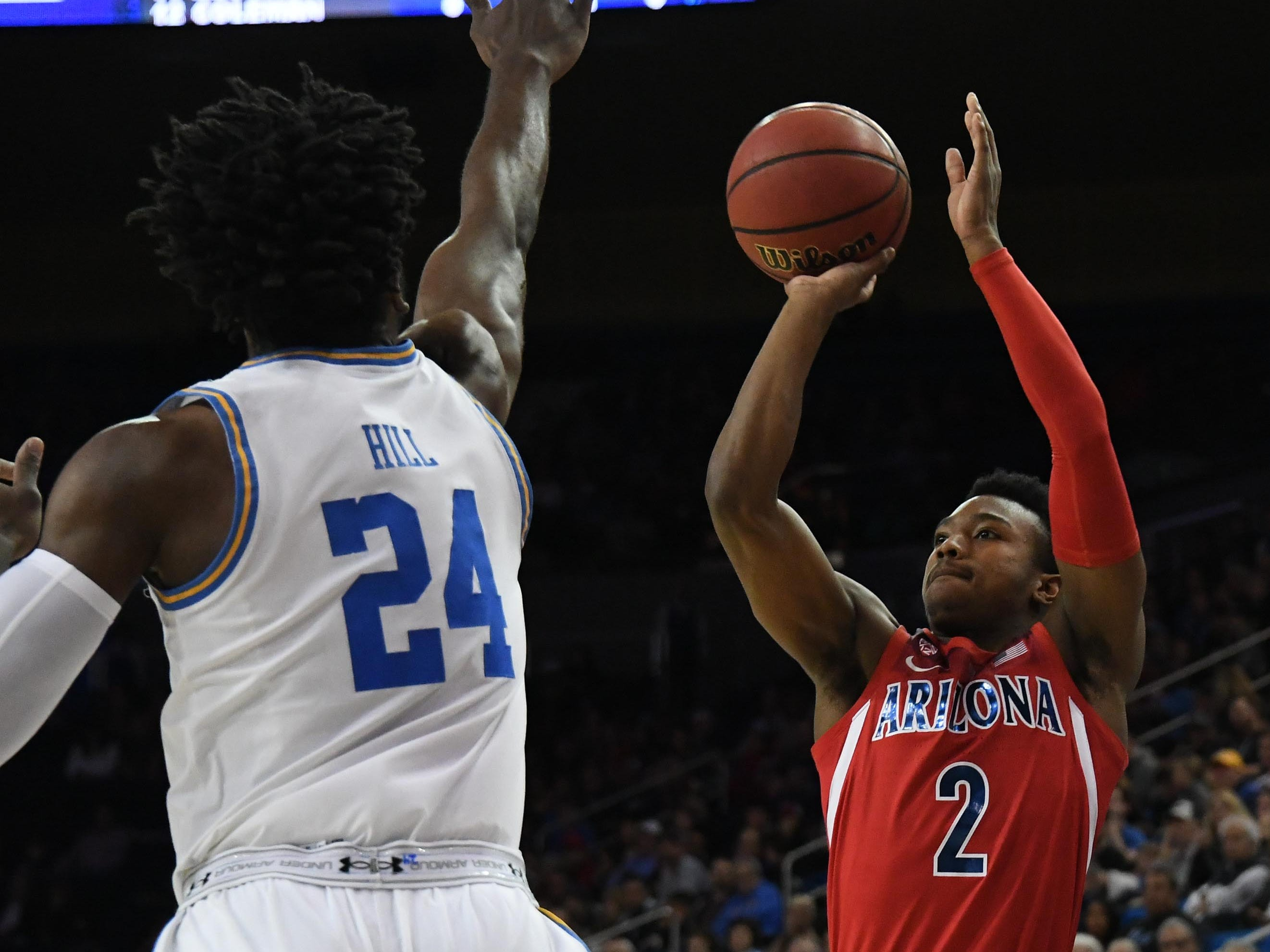 Jan 26, 2019; Los Angeles, CA, USA; Arizona Wildcats guard Brandon Williams (2) shoots against UCLA Bruins guard Jalen Hill (24) in the first half at Pauley Pavilion.