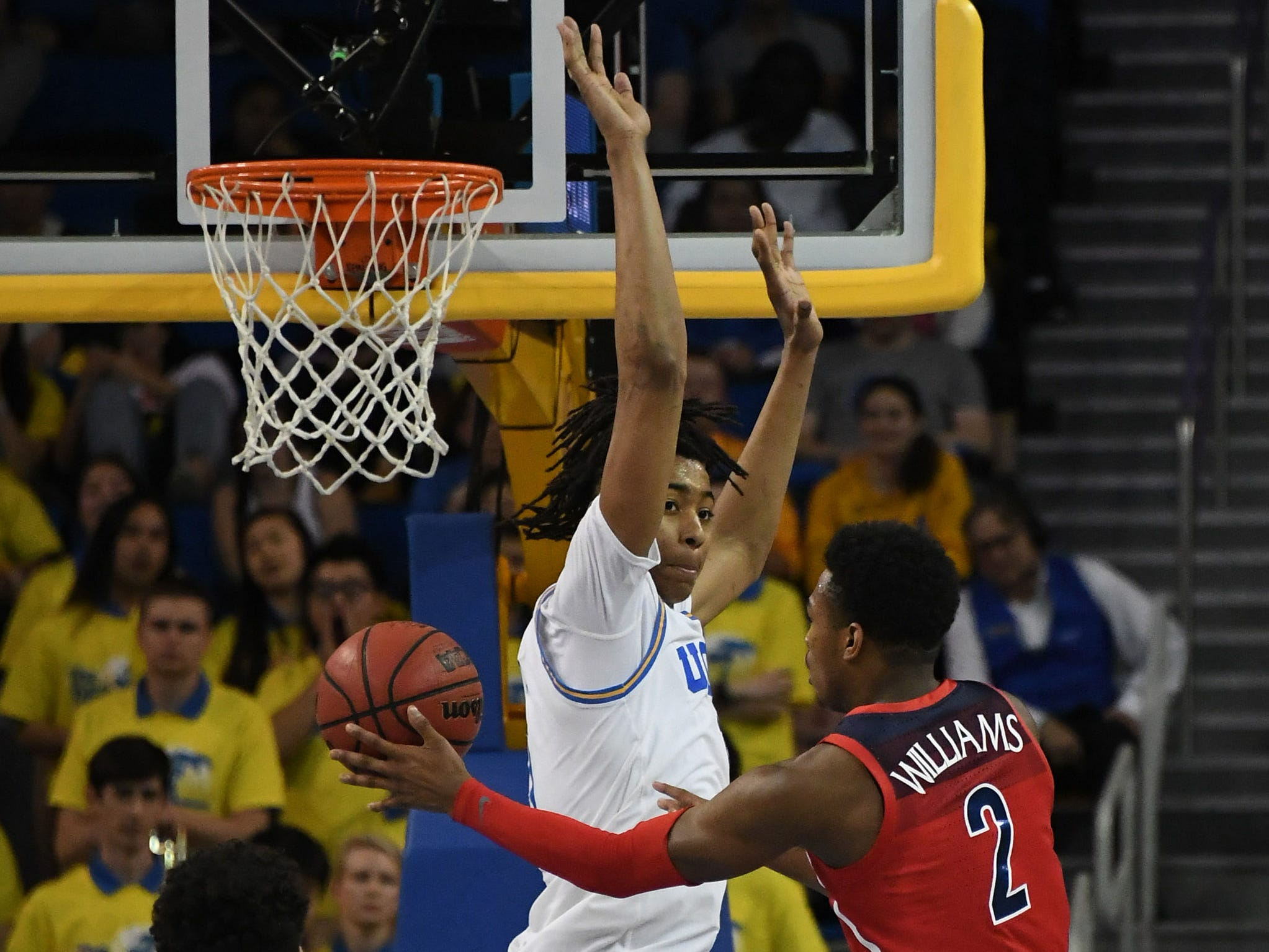 Jan 26, 2019; Los Angeles, CA, USA; Arizona Wildcats guard Brandon Williams (2) shoots against UCLA Bruins center Moses Brown (1) in the second half at Pauley Pavilion.