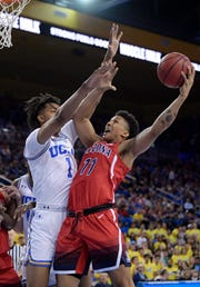 Arizona forward Ira Lee, right, shoots as UCLA center Moses Brown defends during the first half of an NCAA college basketball game Saturday, Jan. 26, 2019, in Los Angeles.