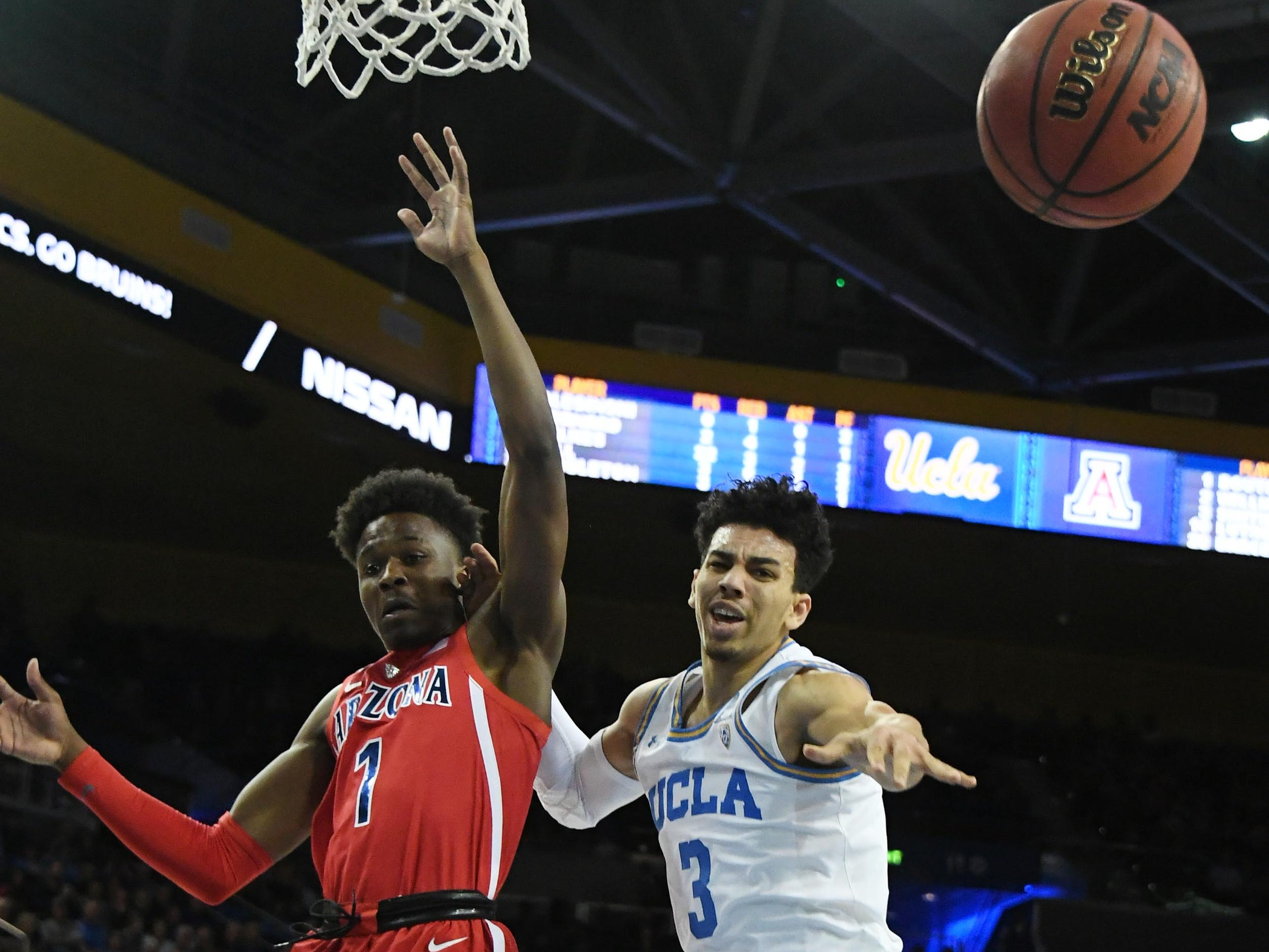 Jan 26, 2019; Los Angeles, CA, USA; UCLA Bruins guard Jules Bernard (3) passes the ball away from Arizona Wildcats guard Devonaire Doutrive (1) in the second half at Pauley Pavilion.