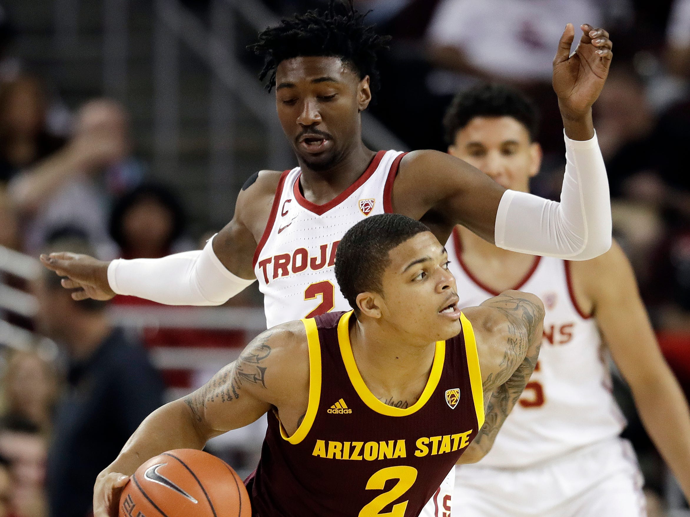 Arizona State guard Rob Edwards, bottom, is defended by Southern California guard Jonah Mathews during the first half of an NCAA college basketball game Saturday, Jan. 26, 2019, in Los Angeles.