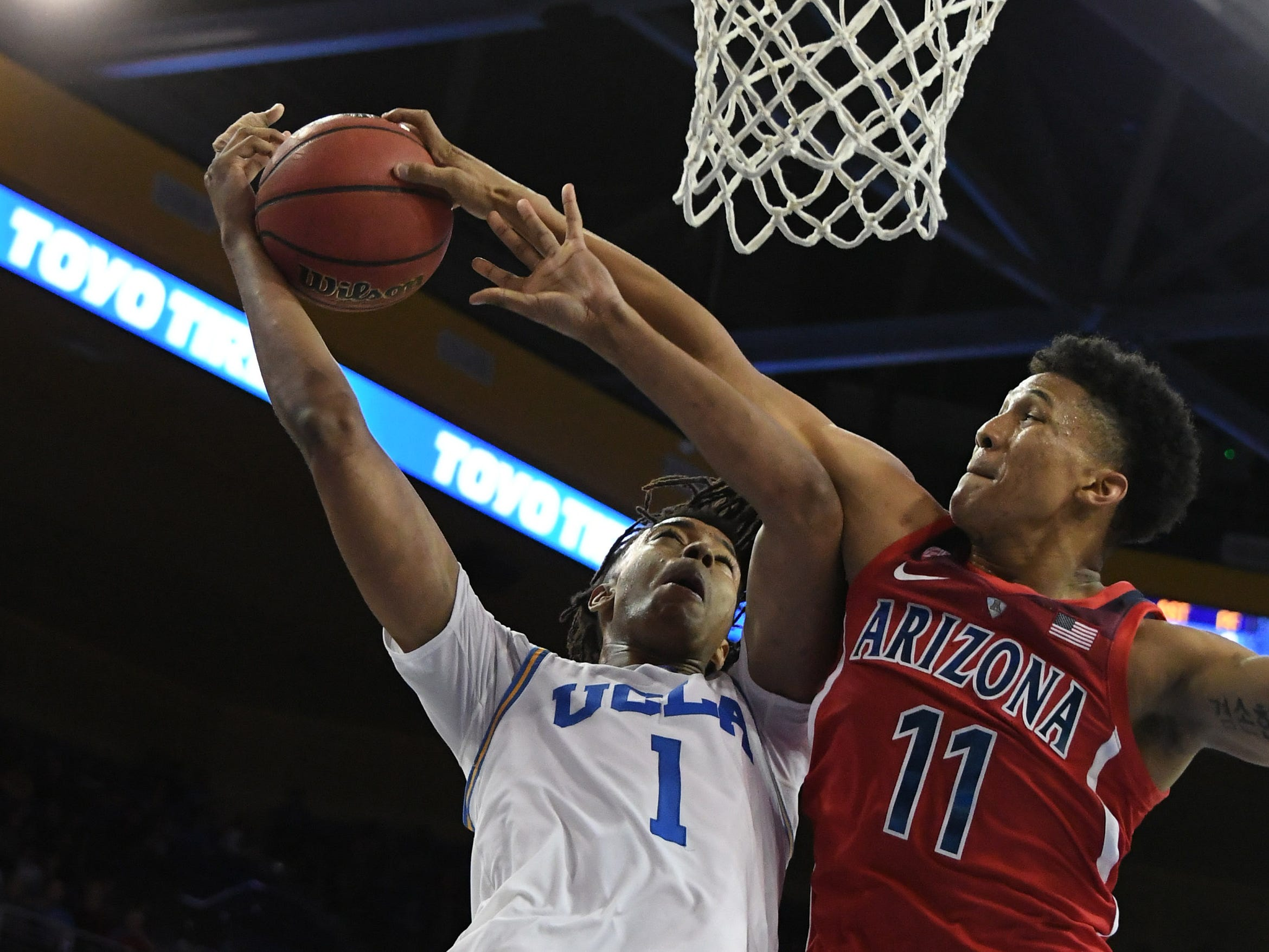 Jan 26, 2019; Los Angeles, CA, USA; UCLA Bruins center Moses Brown (1) has his shot blocked by Arizona Wildcats forward Ira Lee (11) in the second half at Pauley Pavilion.