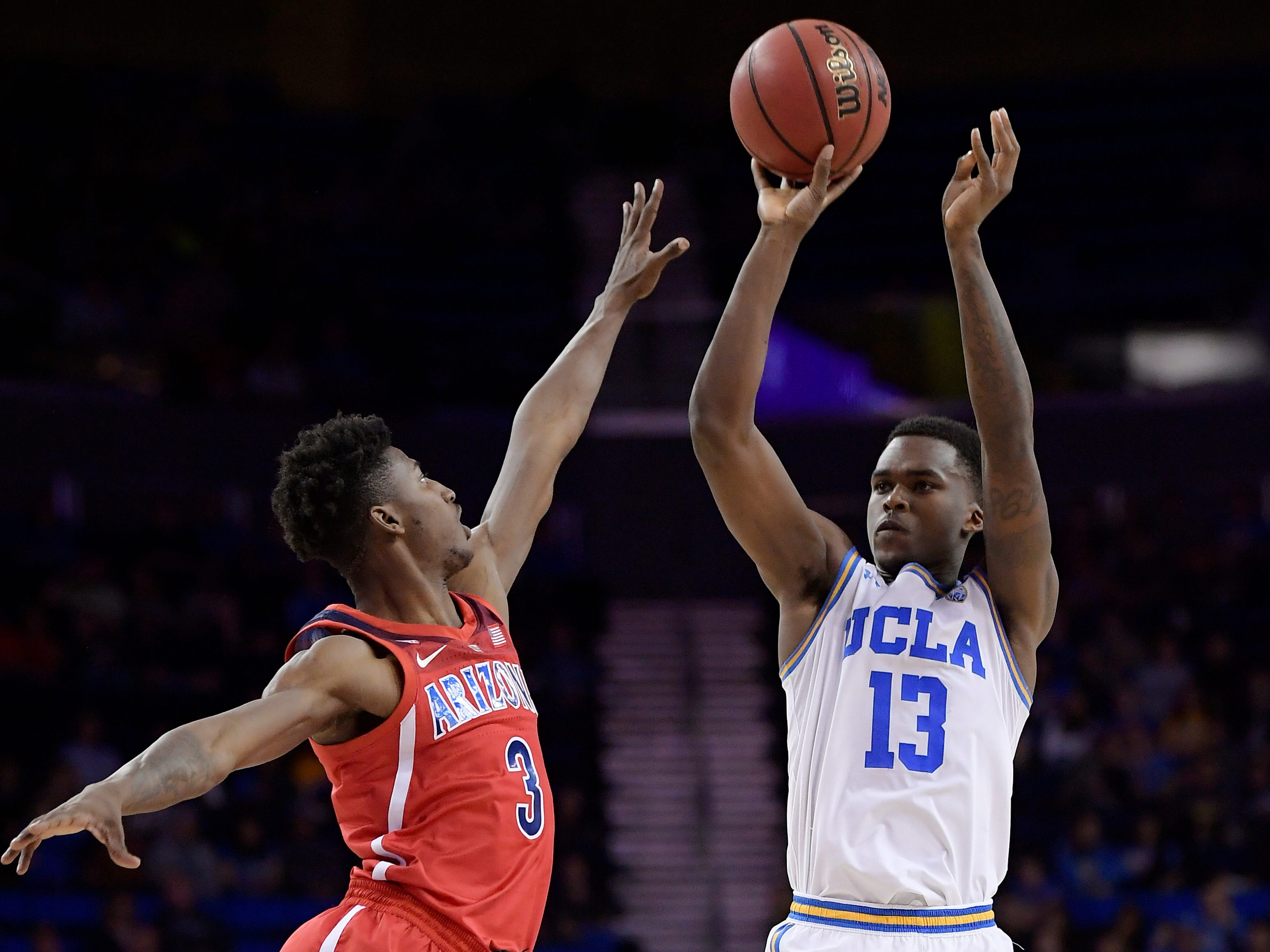 UCLA guard Kris Wilkes, right, shoots as Arizona guard Dylan Smith defends during the second half of an NCAA college basketball game Saturday, Jan. 26, 2019, in Los Angeles. UCLA won 90-69.