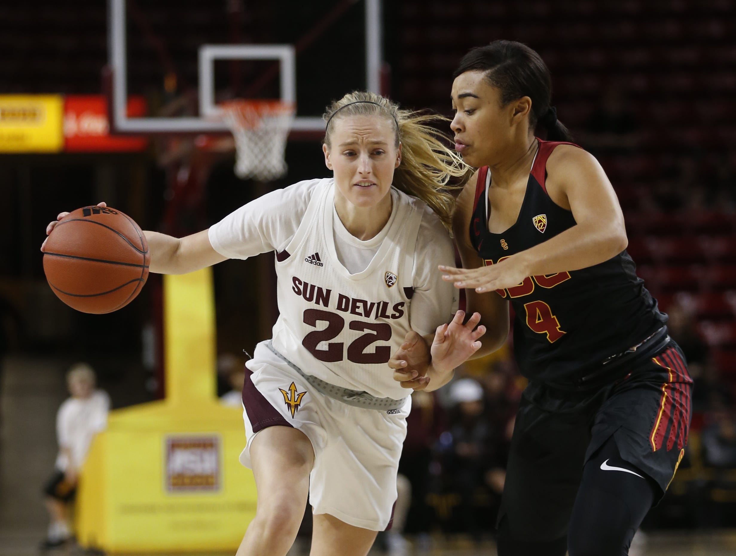 ASU's Courtney Ekmark (22) drives on USC's Mariya Moore (4) during the first half at Wells Fargo Arena in Tempe, Ariz. on January 27, 2019.