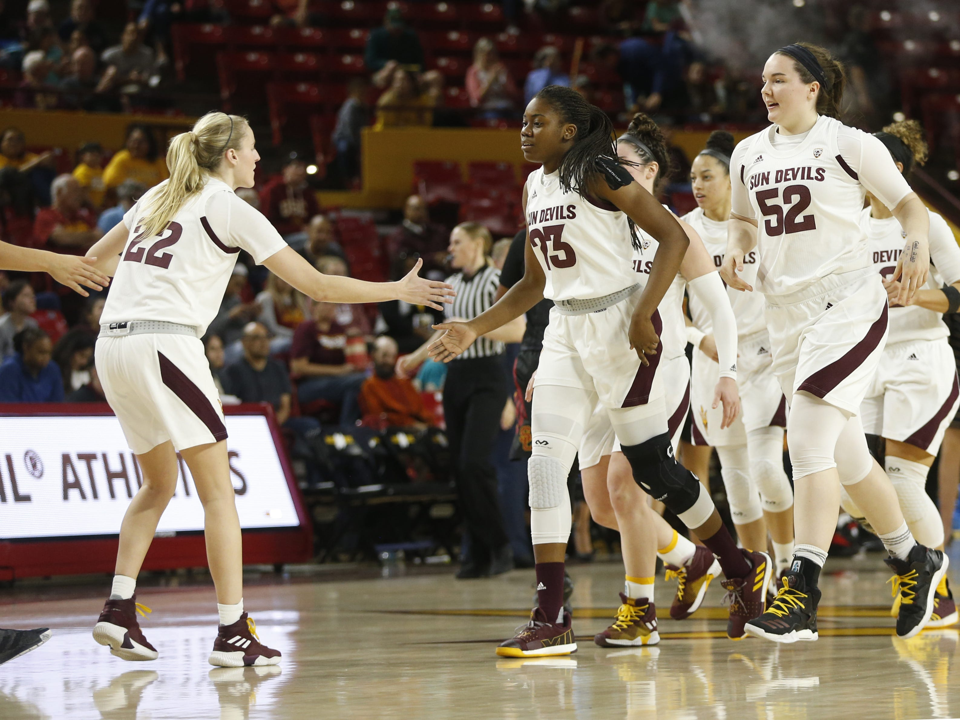 ASU's Courtney Ekmark (22) high-fives teammate Iris Mbulito (23) during the second half against USC at Wells Fargo Arena in Tempe, Ariz. on January 27, 2019.