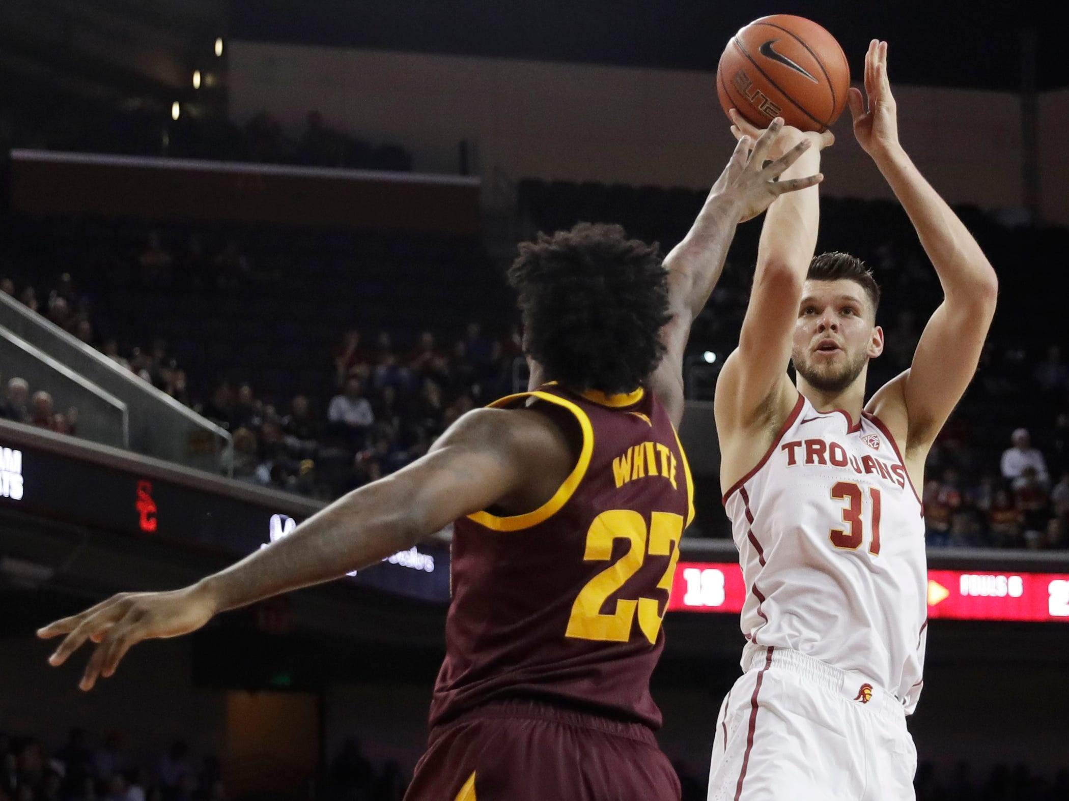 Southern California forward Nick Rakocevic (31) shoots over Arizona State forward Romello White (23) during the first half of an NCAA college basketball game Saturday, Jan. 26, 2019, in Los Angeles.