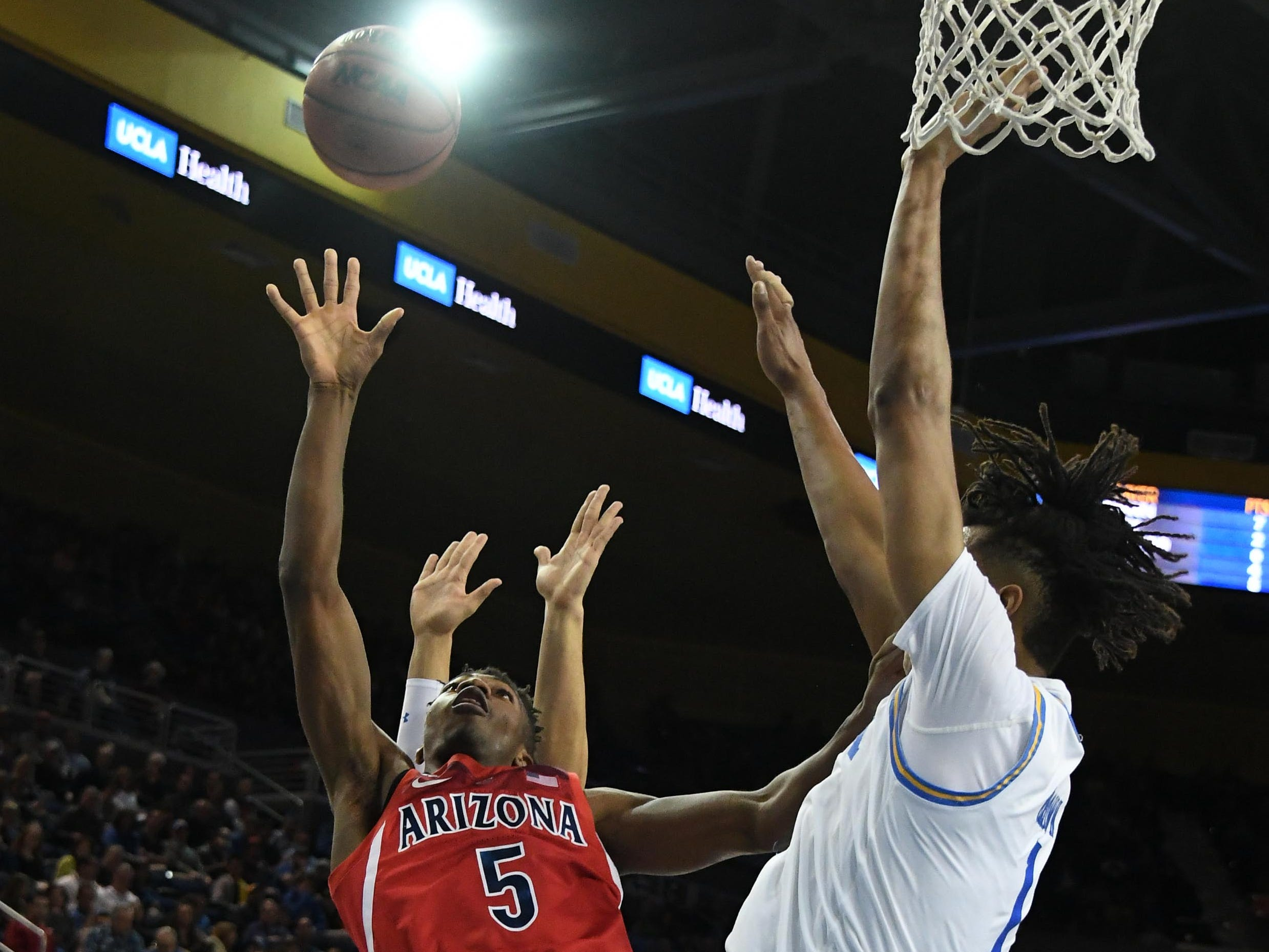 Jan 26, 2019; Los Angeles, CA, USA; Arizona Wildcats guard Brandon Randolph (5) shoots against the UCLA Bruins in the first half at Pauley Pavilion.
