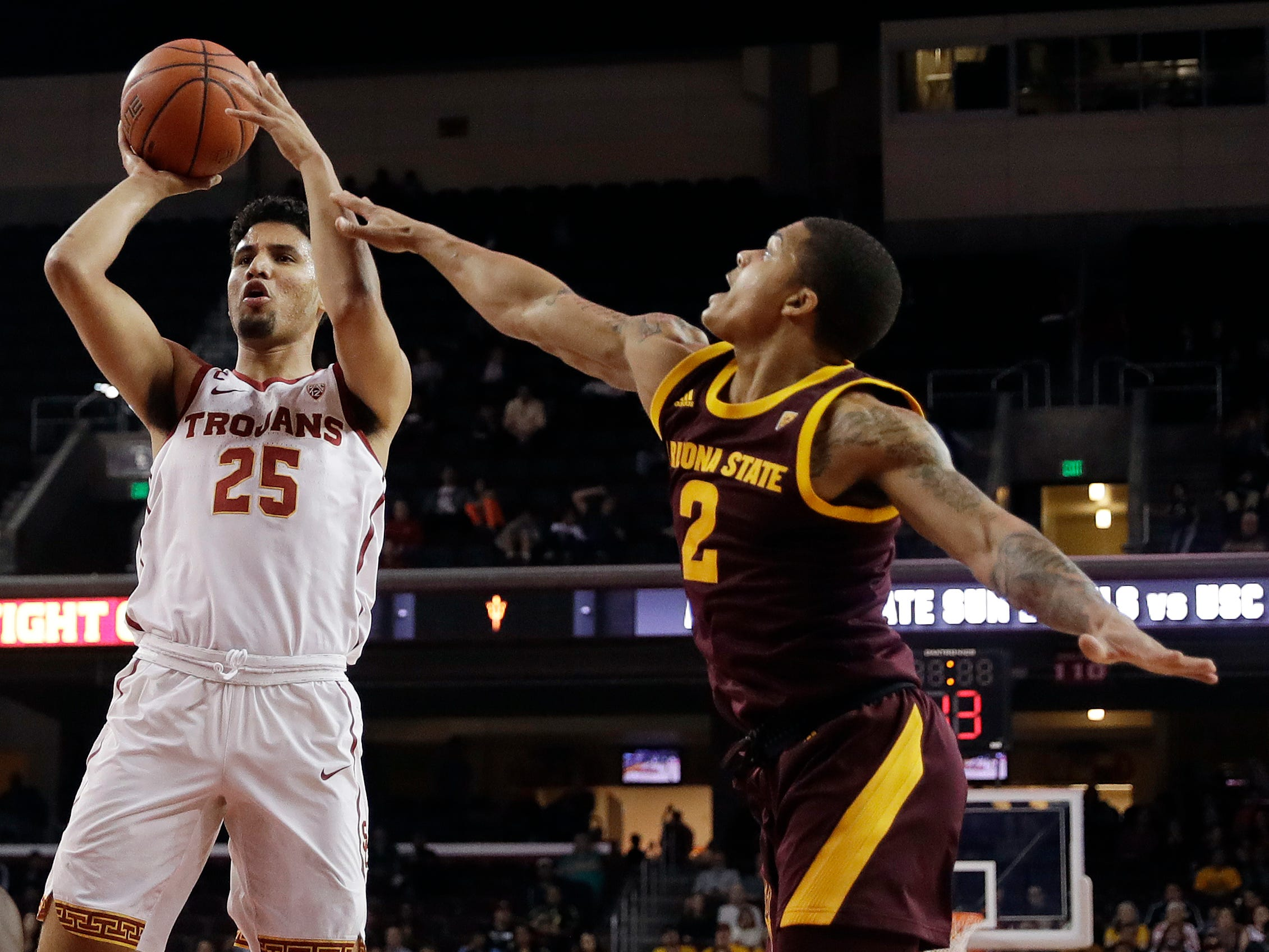 Southern California forward Bennie Boatwright (25) shoots next to Arizona State guard Rob Edwards (2) during the first half of an NCAA college basketball game Saturday, Jan. 26, 2019, in Los Angeles.