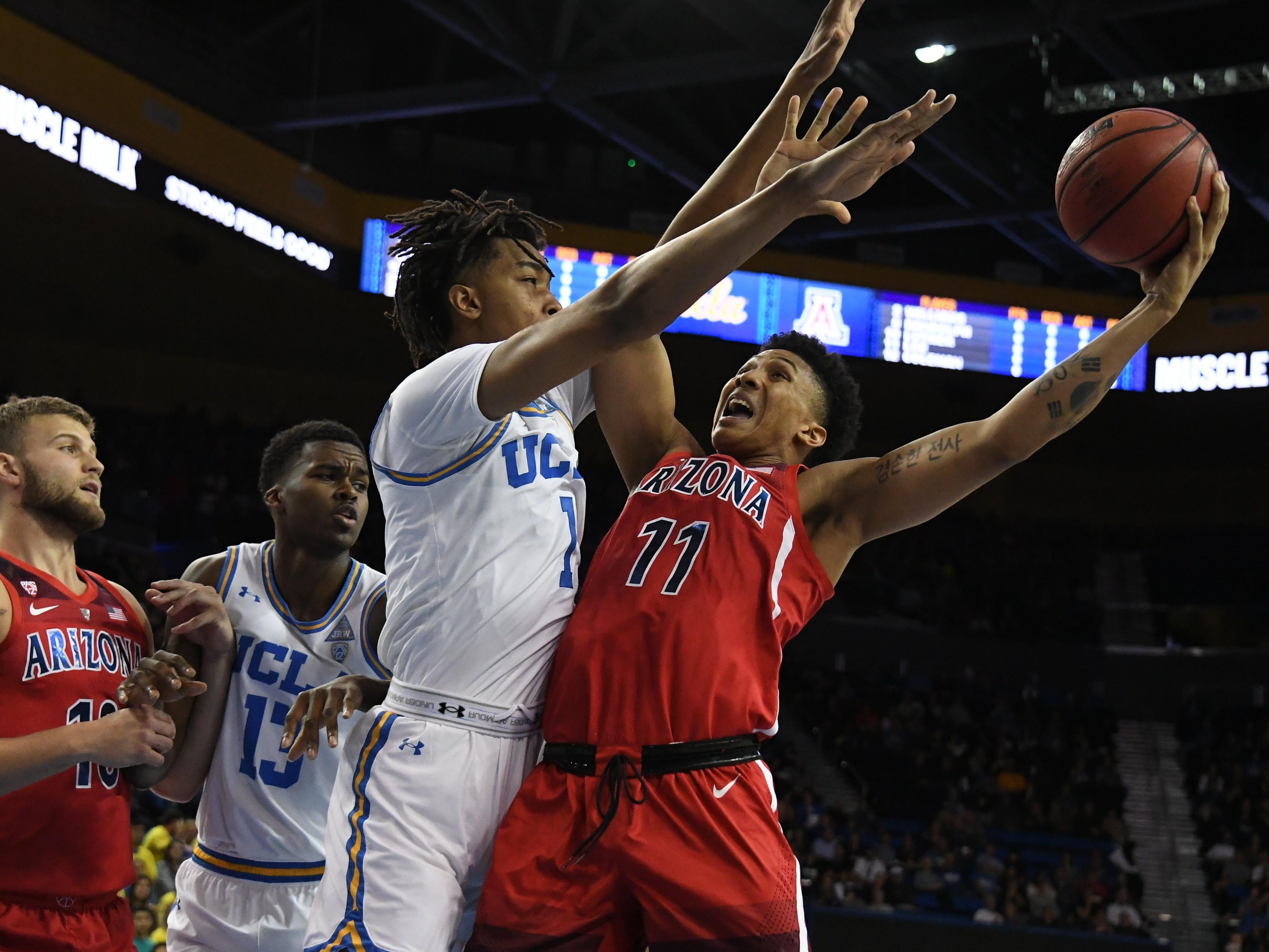 Jan 26, 2019; Los Angeles, CA, USA; Arizona Wildcats forward Ira Lee (11) shoots against UCLA Bruins center Moses Brown (1) in the first half at Pauley Pavilion.