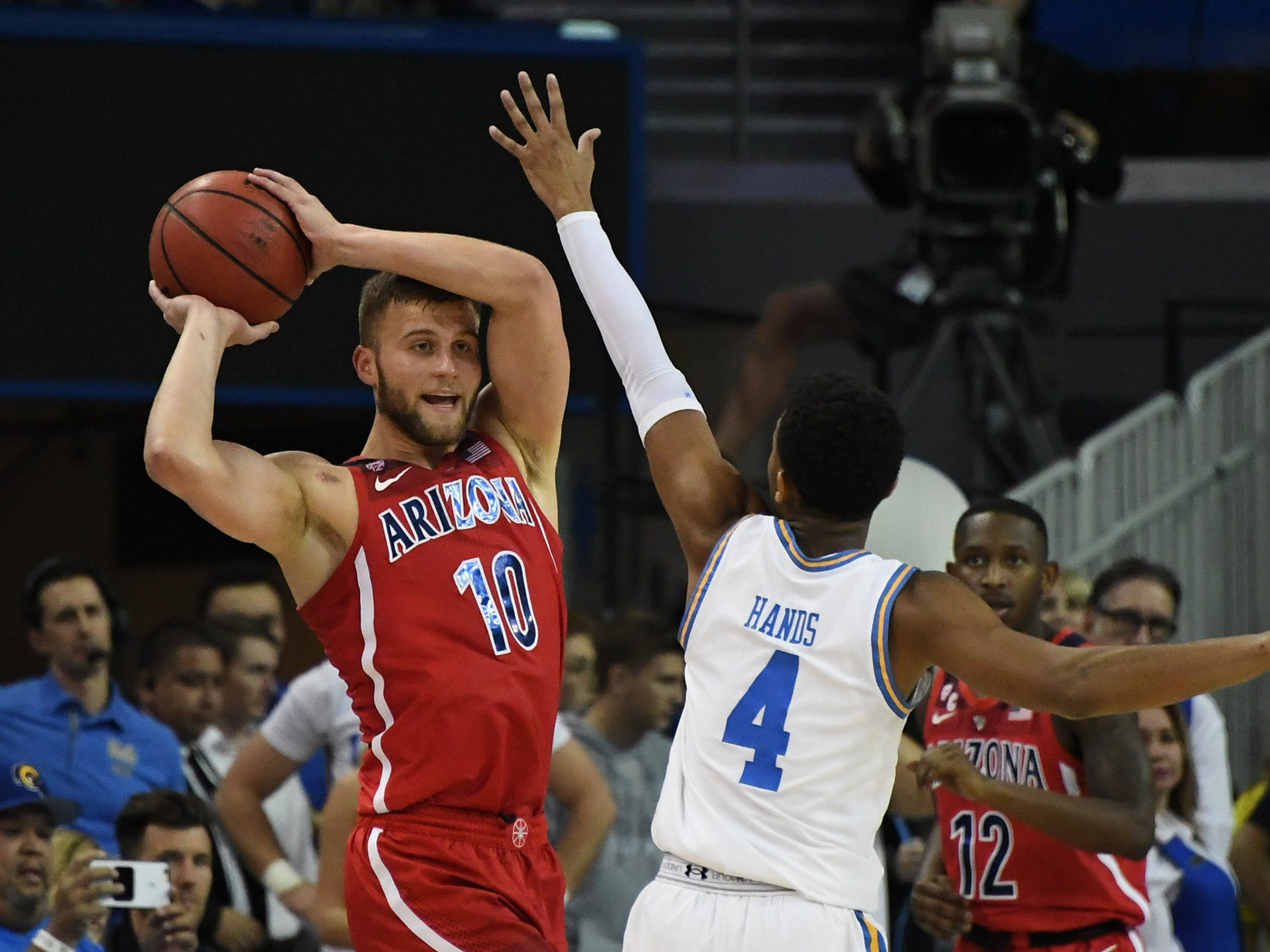 Jan 26, 2019; Los Angeles, CA, USA; Arizona Wildcats forward Ryan Luther (10) holds the ball away from UCLA Bruins guard Jaylen Hands (4) in the second half at Pauley Pavilion.