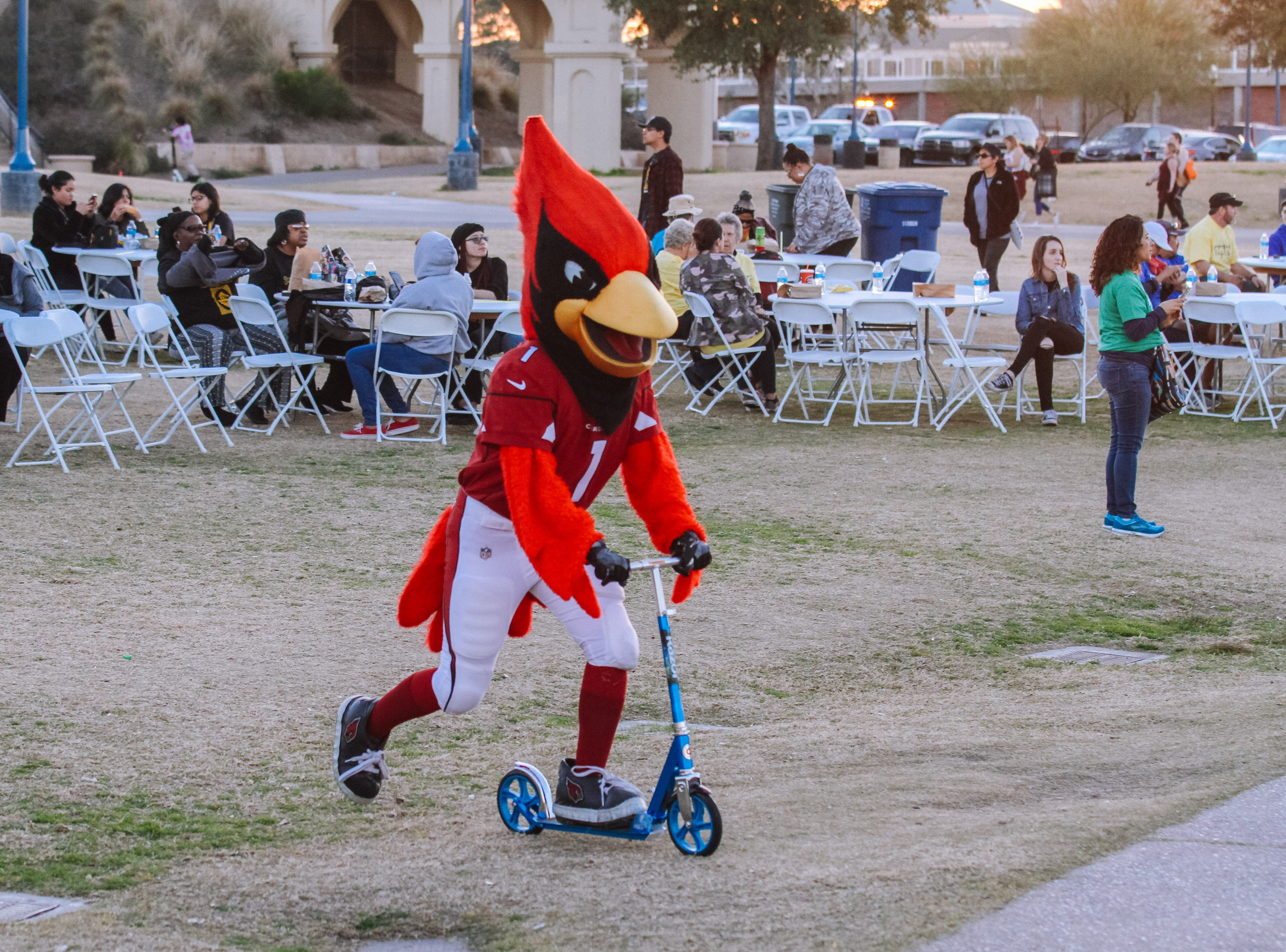 Big Red rides a scooter while at the Unity Walk 2019 at Tempe Beach Park, in Tempe, Arizona on Saturday, Jan. 26, 2019.