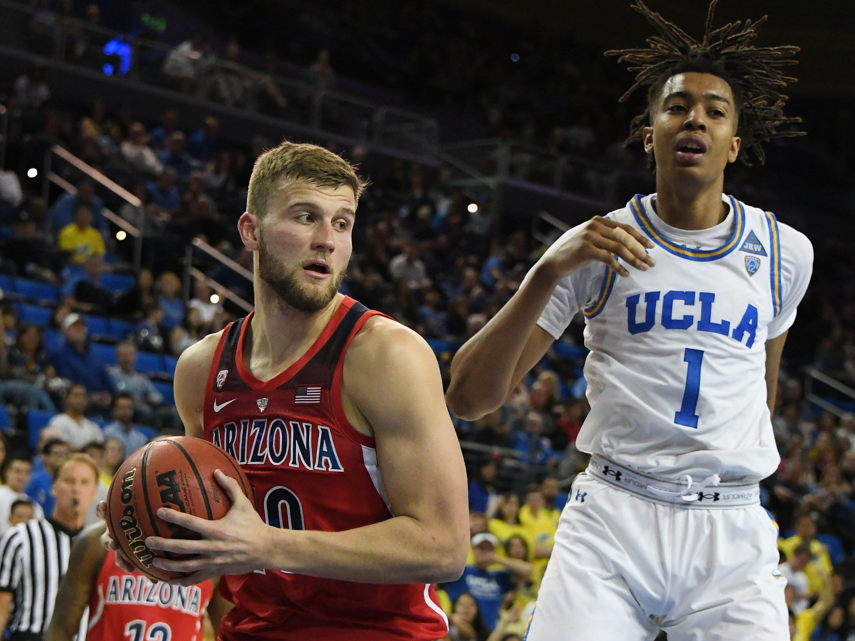 Jan 26, 2019; Los Angeles, CA, USA; Arizona Wildcats forward Ryan Luther (10) rebounds the ball in front of UCLA Bruins center Moses Brown (1) in the second half at Pauley Pavilion.