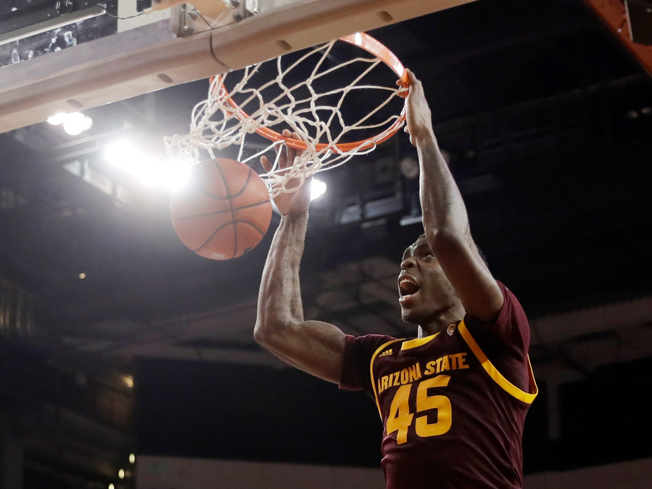 Arizona State forward Zylan Cheatham (45) dunks over Southern California forward J'Raan Brooks (33) during the second half of an NCAA college basketball game Saturday, Jan. 26, 2019, in Los Angeles.
