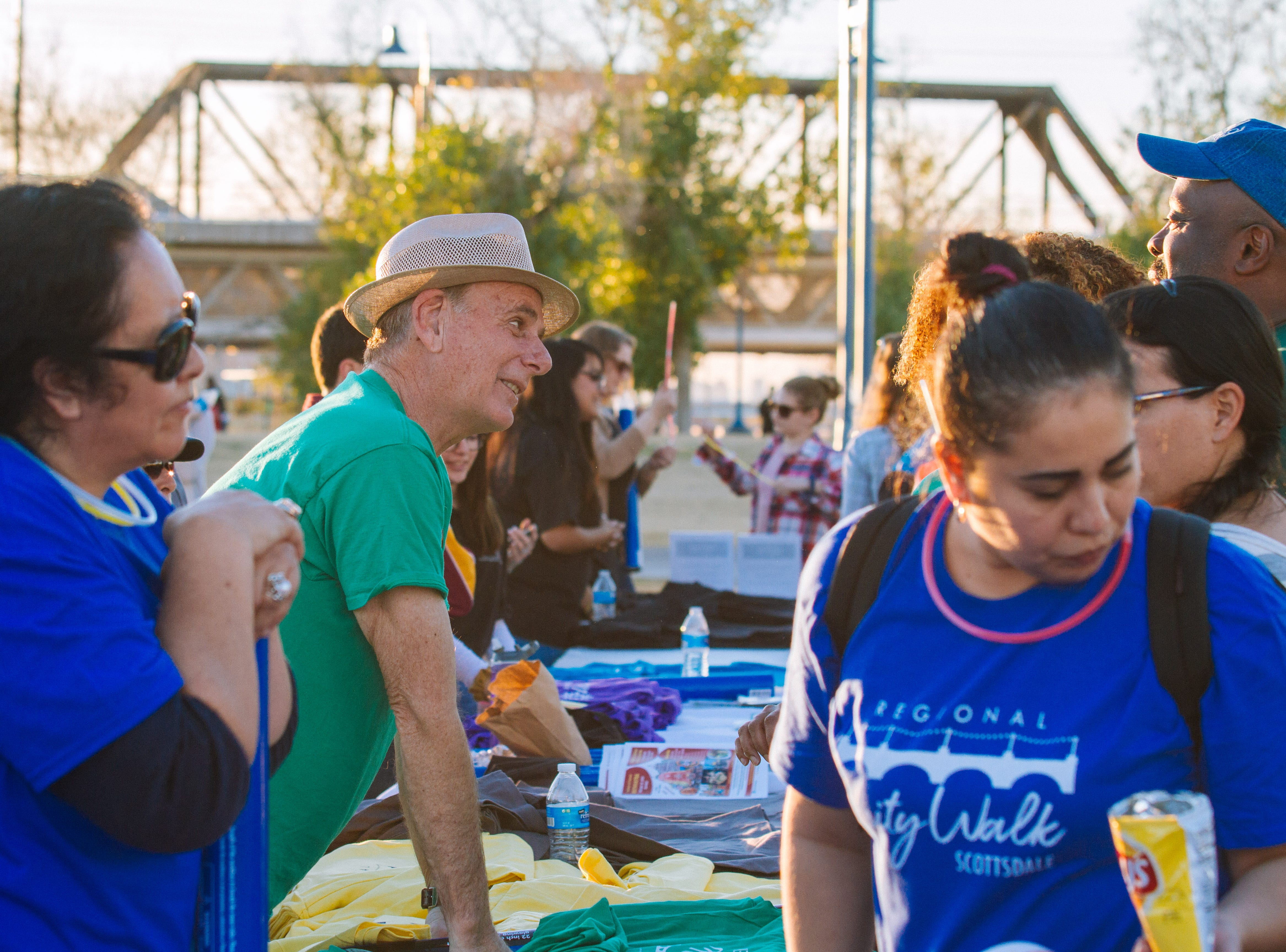 T-shirts are handed out to participants at the Unity Walk 2019 at Tempe Beach Park, in Tempe, Arizona on Saturday, Jan. 26, 2019.