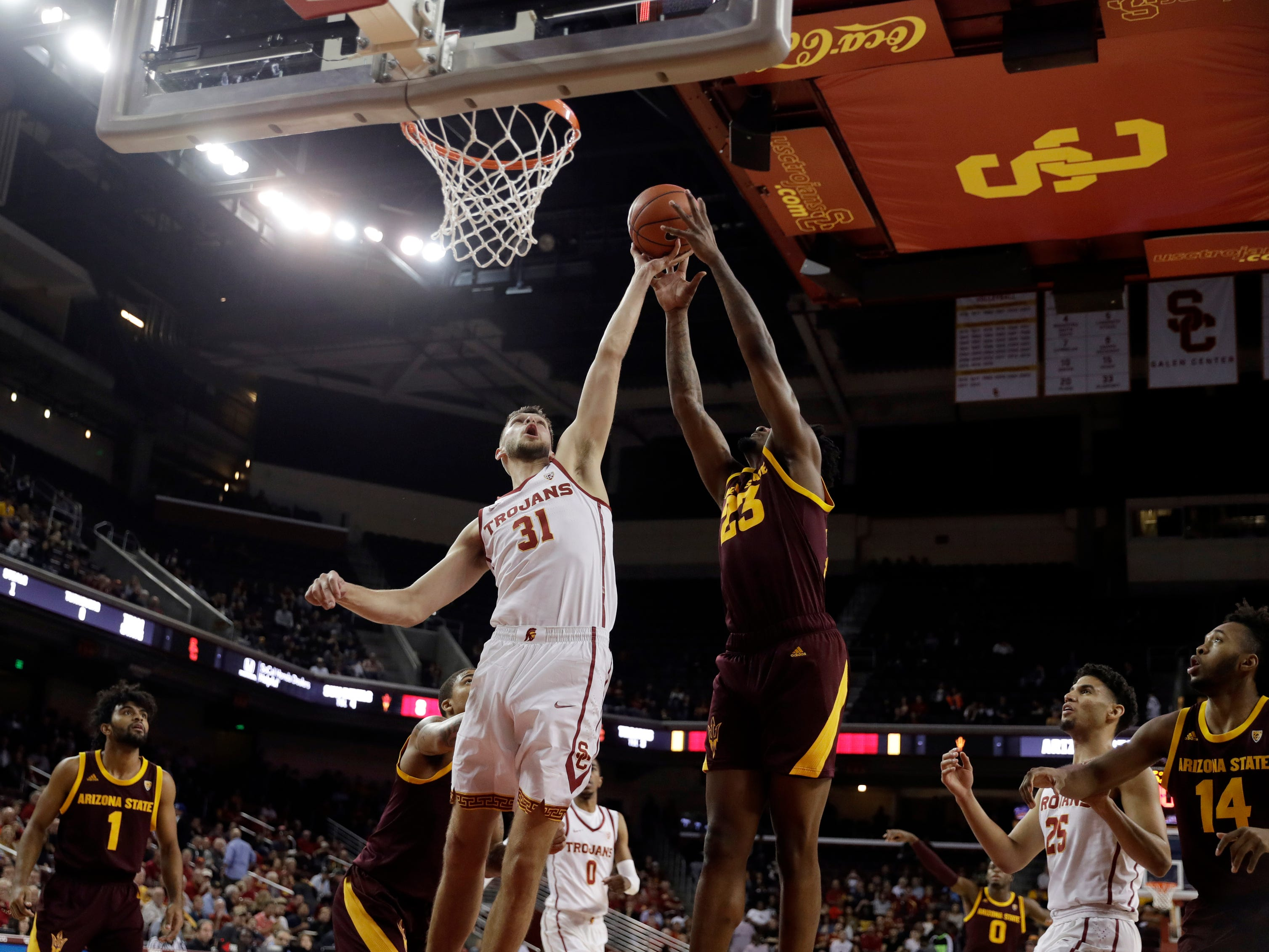 Southern California forward Nick Rakocevic (31) works for a rebound against Arizona State forward Romello White (23) during the first half of an NCAA college basketball game Saturday, Jan. 26, 2019, in Los Angeles.