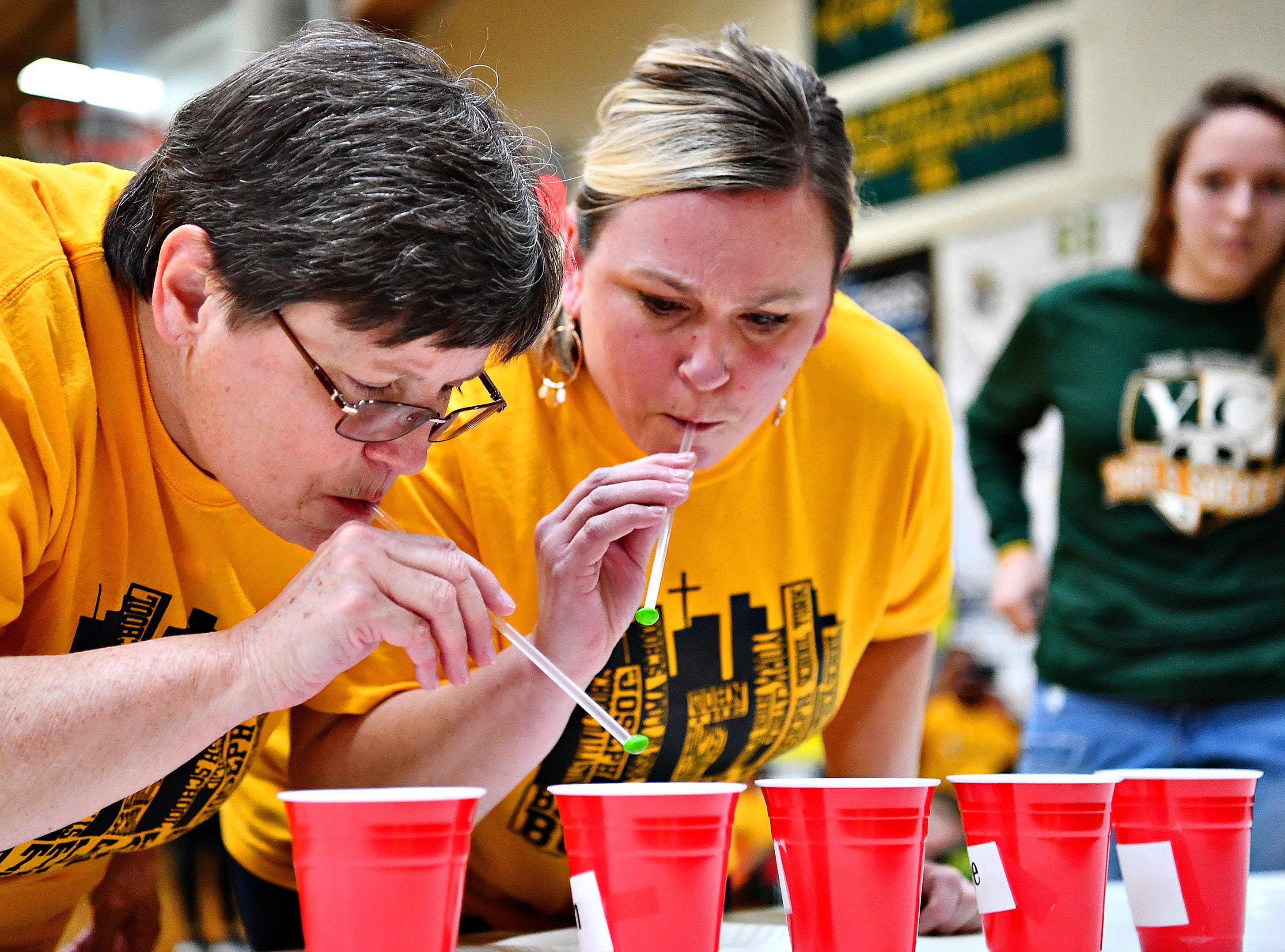St. Joseph School of York's fourth grade teacher Helen Livingston, left, and 5th/6th grade science teacher Jennifer Sister compete in the Chase the Rainbow contest during Battle of the Buildings at York Catholic High School in York City, Saturday, Jan. 26, 2019. Dawn J. Sagert photo