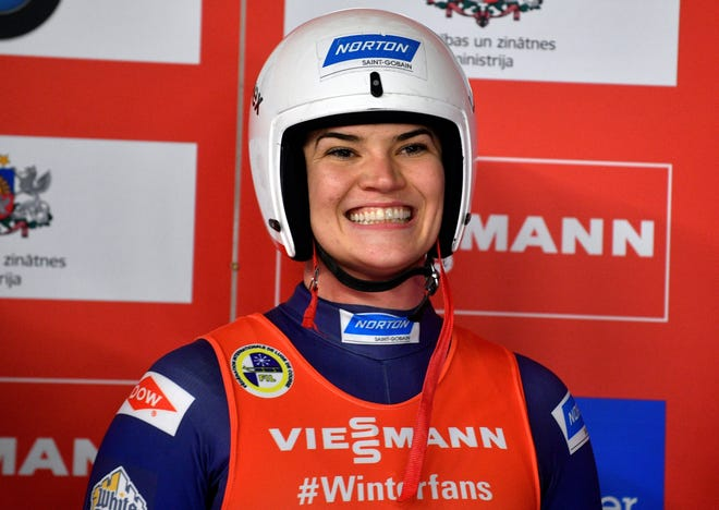 Summer Britcher of United States smiles after she placed third of a women's race at the Luge World Cup event in Sigulda, Latvia, Saturday, Jan. 12, 2019. (AP Photo/Roman Koksarov)