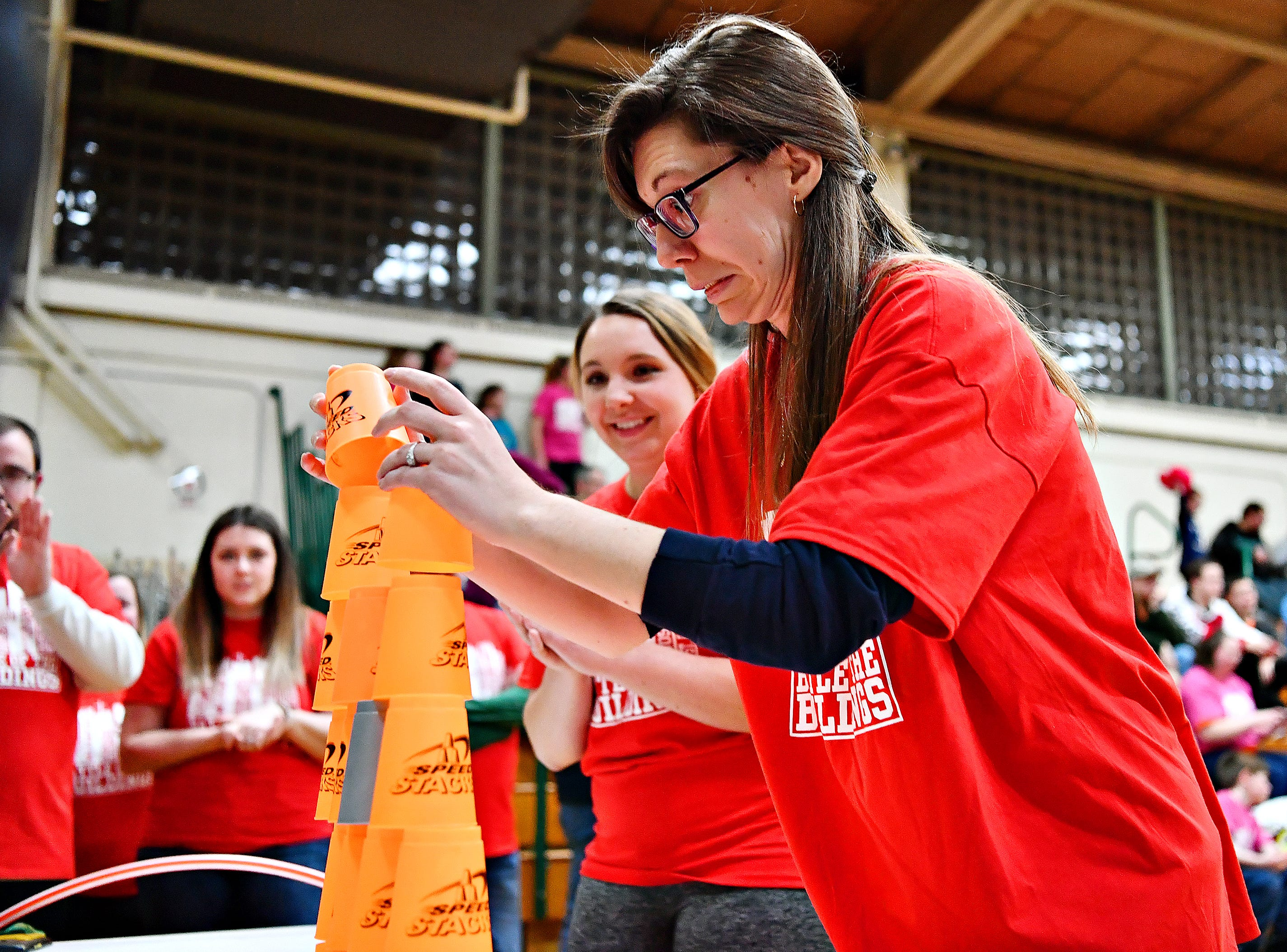 York Catholic guidance counselor Kelsey Khan, back, looks on as she and eighth-grade English teacher and seventh-grade religion teacher Christa Laczkoskic compete in the Stack Attack competition during Battle of the Buildings at York Catholic High School in York City, Saturday, Jan. 26, 2019. Dawn J. Sagert photo