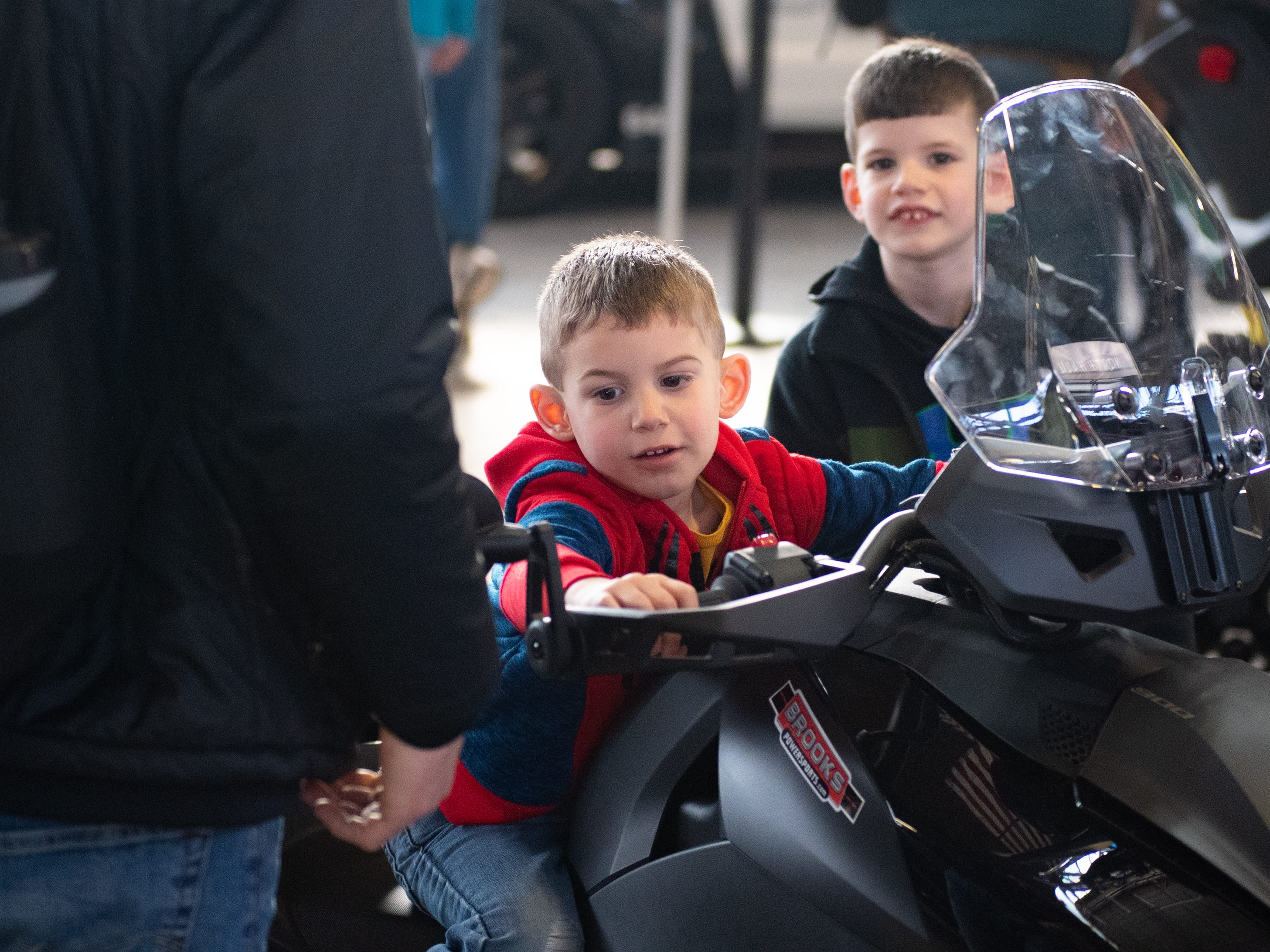 Fionn Garvey takes notes from his father on how to ride a motorcycle during the 2019 Pennsylvania Auto Show, Saturday, January 26, 2019 at the Pennsylvania Farm Show Complex & Expo Center. The auto show continues on Sunday from 10 a.m. to 5 p.m.