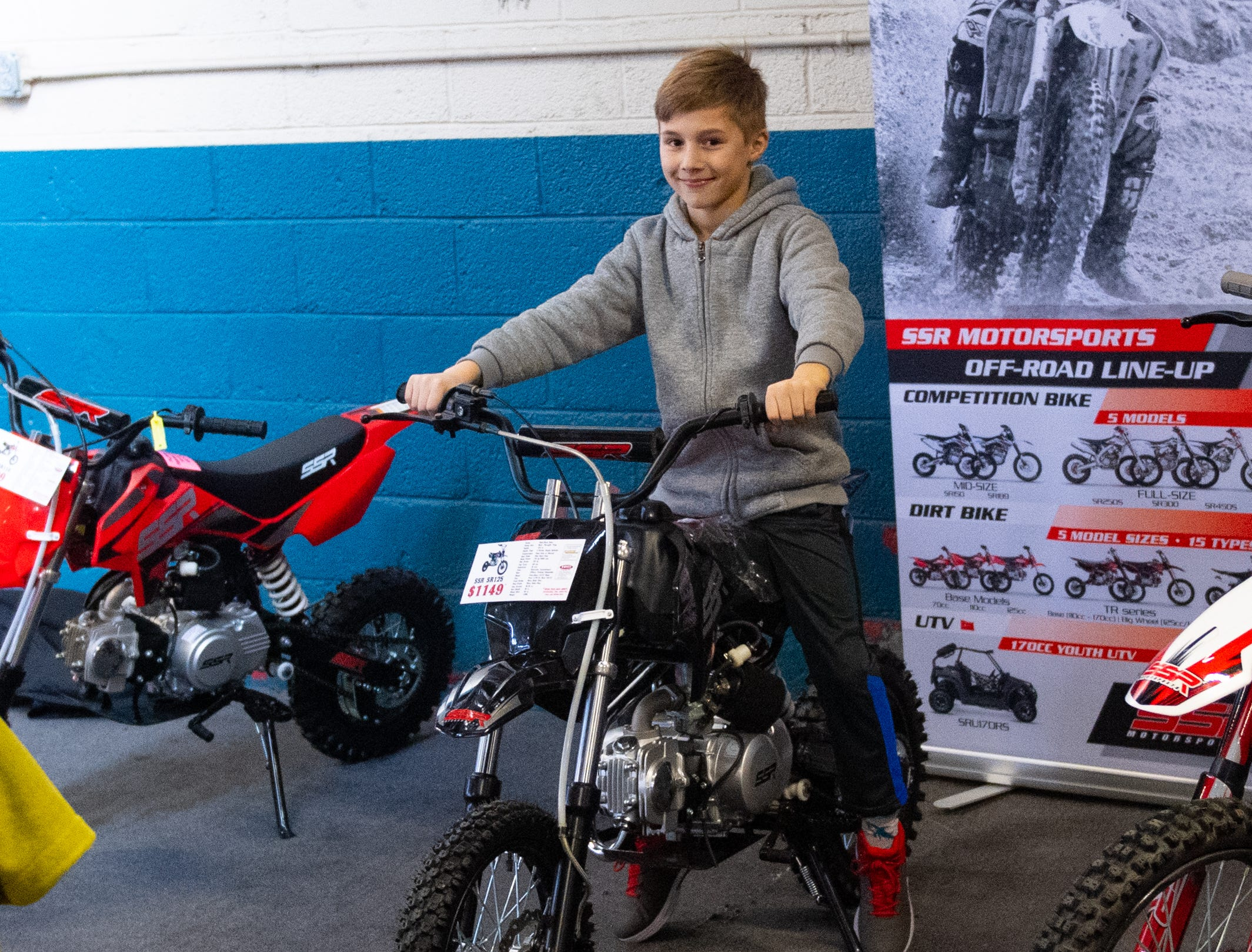 Tyler Secor tries out a dirt bike during the 2019 Pennsylvania Auto Show, Saturday, January 26, 2019 at the Pennsylvania Farm Show Complex & Expo Center. The auto show continues on Sunday from 10 a.m. to 5 p.m.