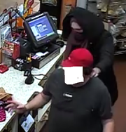 A man wearing a mask and a women's coat holds a Sheetz employee at gunpoint while robbing the store in Mount Joy.