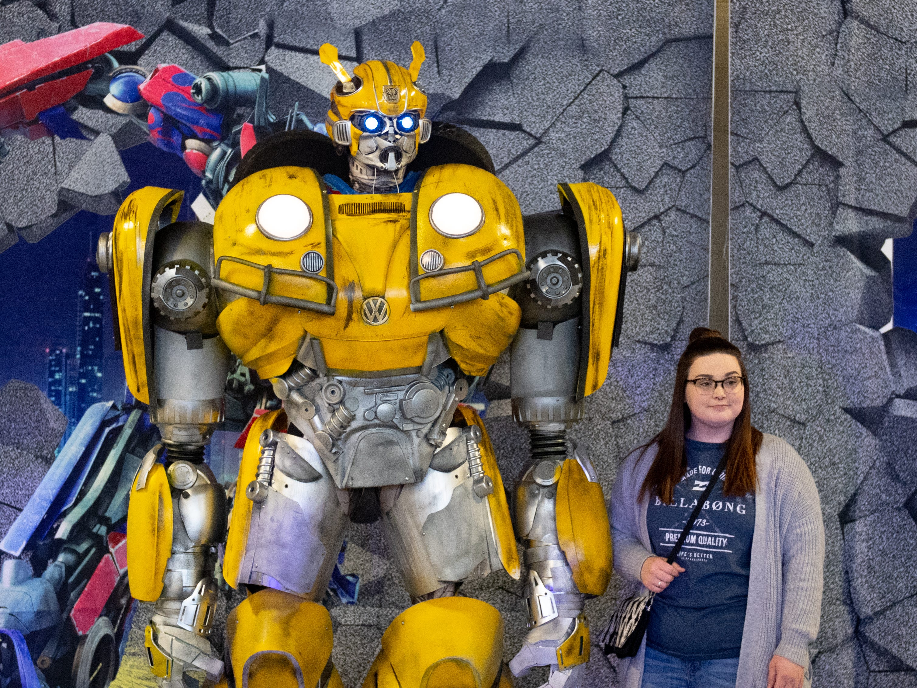 Guests take pictures with Bumblebee from Transformers during the 2019 Pennsylvania Auto Show, Saturday, January 26, 2019 at the Pennsylvania Farm Show Complex & Expo Center. The auto show continues on Sunday from 10 a.m. to 5 p.m.