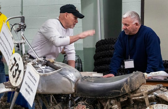 Terry Cunningham, left, talks with volunteer Randy Marshall. Cunningham, a four-time national enduro champion, was talking to fans and signing autographs during the Potomac Vintage Riders' York Swap Meet this past weekend at the York Expo Center.