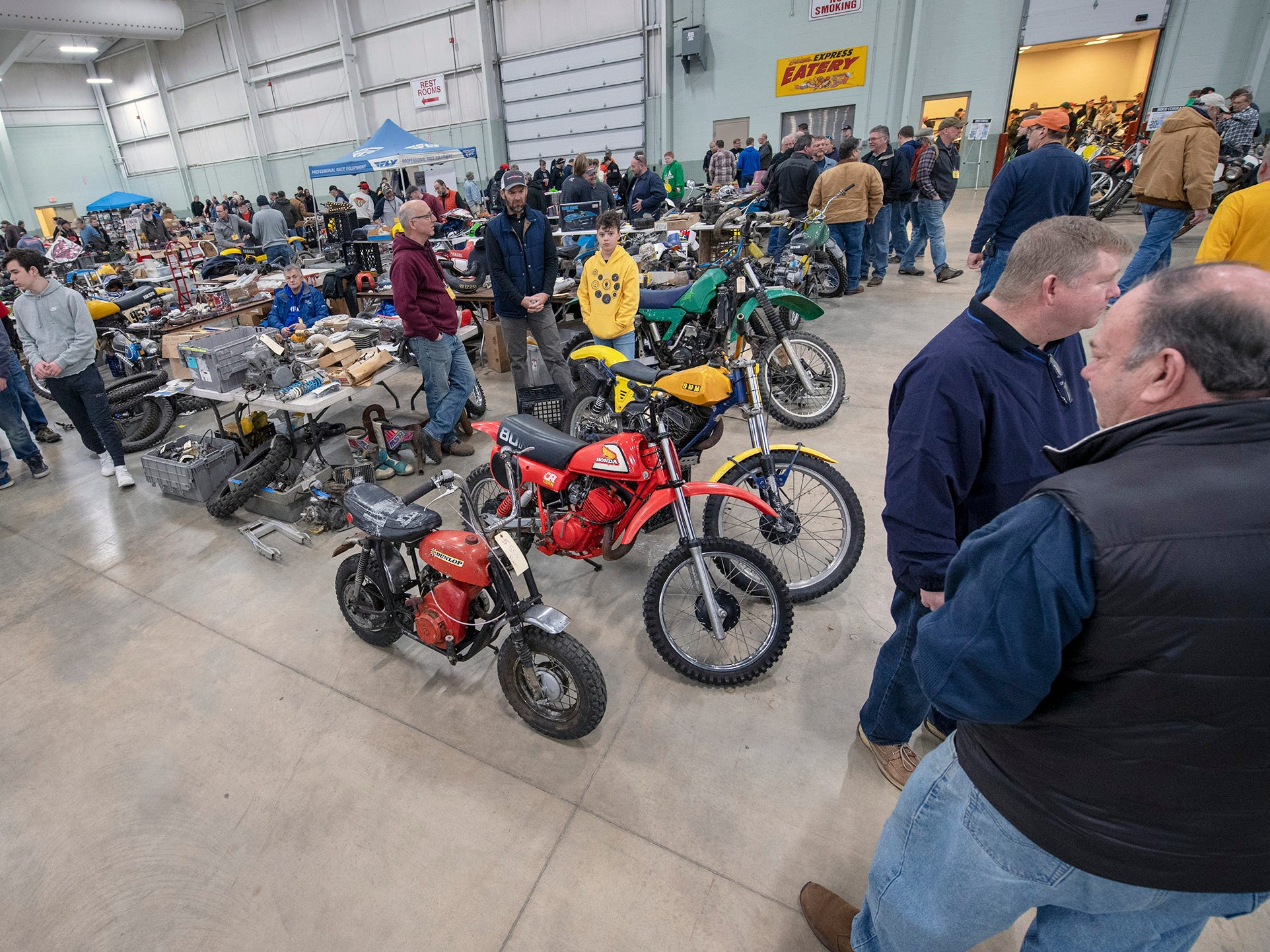Visitors look over used bikes and parts during the The Potomac Vintage Riders' York Swap Meet Sunday January 27, 2019 at the York Expo Center.
