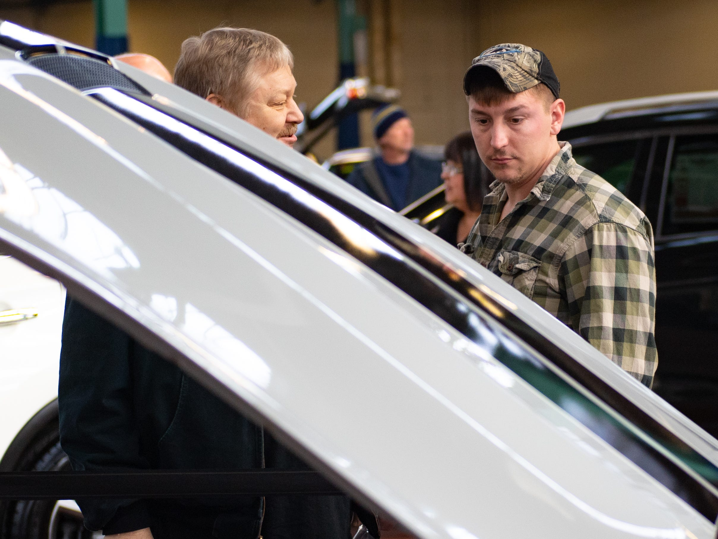 Exhibitors check out the hundreds of cars on display during the 2019 Pennsylvania Auto Show, Saturday, January 26, 2019 at the Pennsylvania Farm Show Complex & Expo Center. The auto show continues on Sunday from 10 a.m. to 5 p.m.