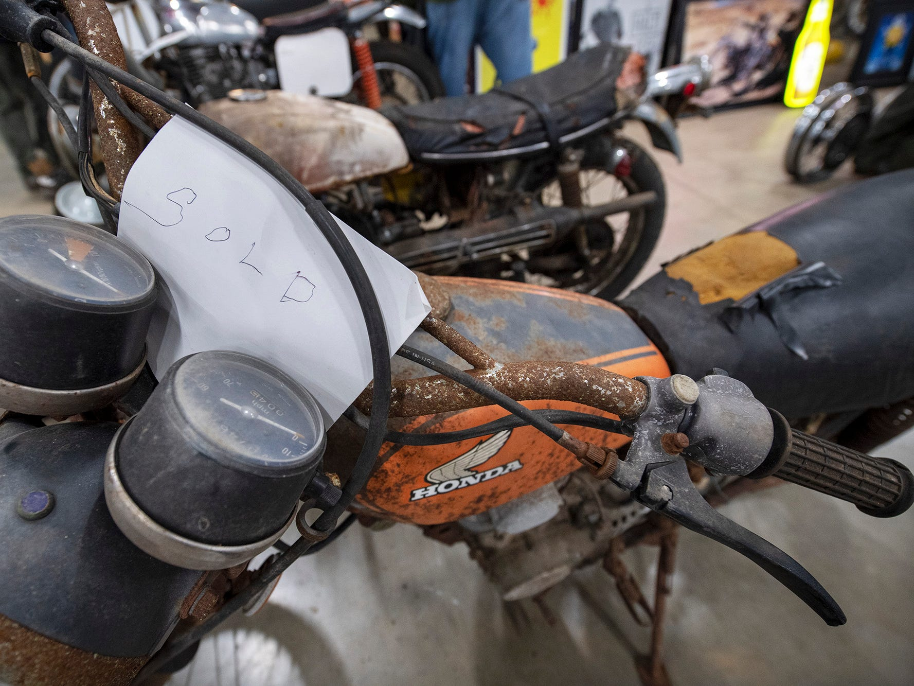 A well weathered Honda motorcycle has a sold sign on it during the The Potomac Vintage Riders' York Swap Meet Sunday January 27, 2019 at the York Expo Center.