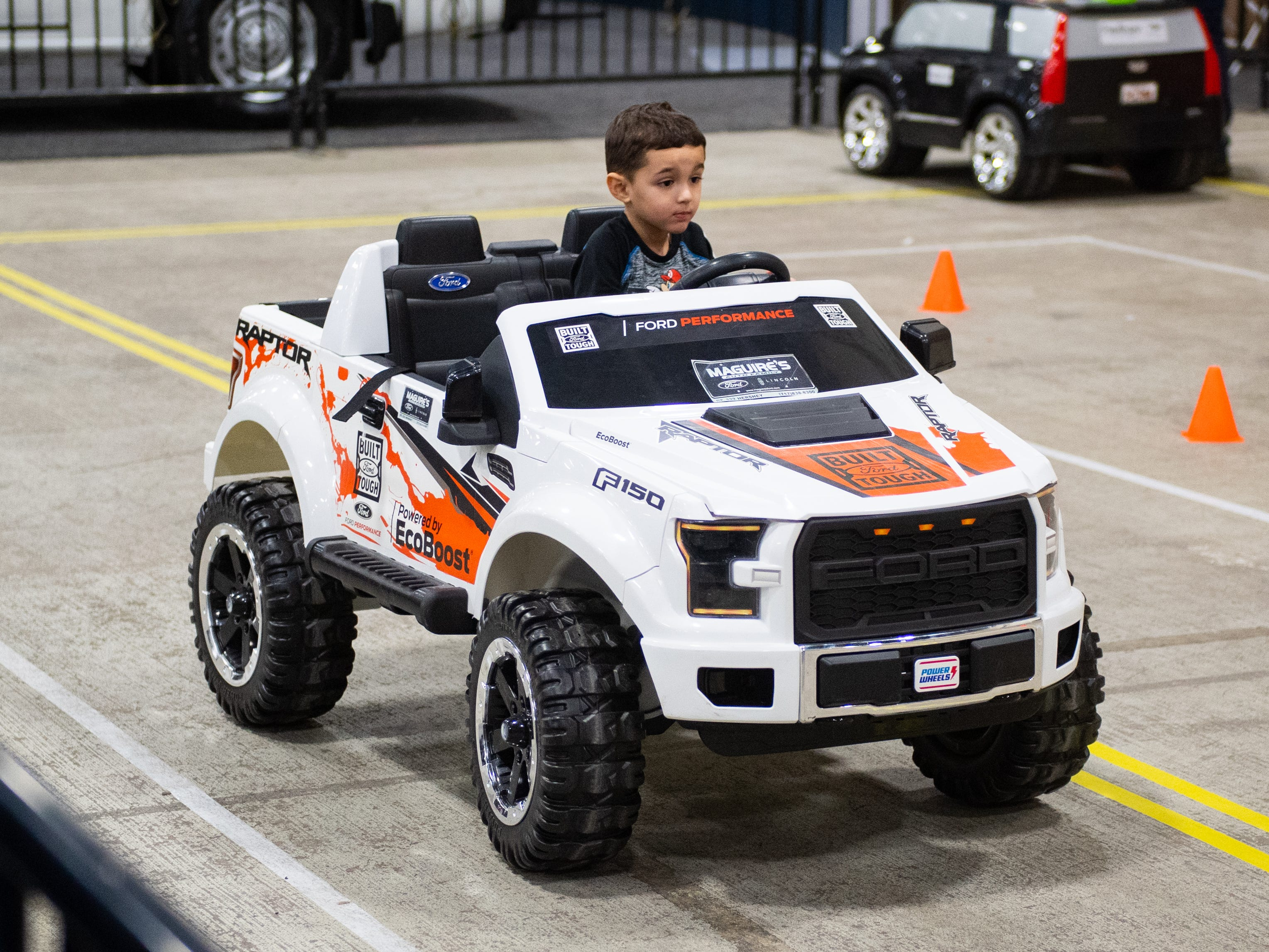 Children test drive their own luxury vehicles at the 2019 Pennsylvania Auto Show, Saturday, January 26, 2019 at the Pennsylvania Farm Show Complex & Expo Center. The auto show continues on Sunday from 10 a.m. to 5 p.m.