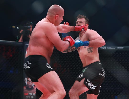 Ryan Bader (blue gloves) and Fedor Emelianenko (red gloves) during Bellator 214 at The Forum.