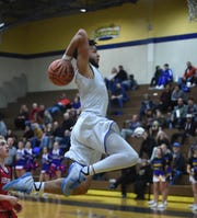 Reed's Matthew Williams goes up to dunk the ball after a steal from Reno in  Tuesday's game at Reed.