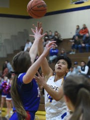 Reed's Shelvy Pascual shoots over Reno's Mia Wilmot during Tuesday's game at Reed.