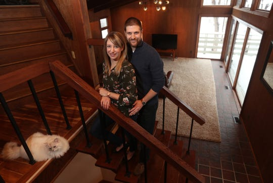 Stephanie and Greg Barg in the living room of their 4,000-square-foot contemporary home in Perinton.