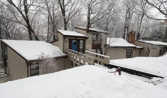 A  4,000 square foot contemporary home in Perinton st on a wooded lot.