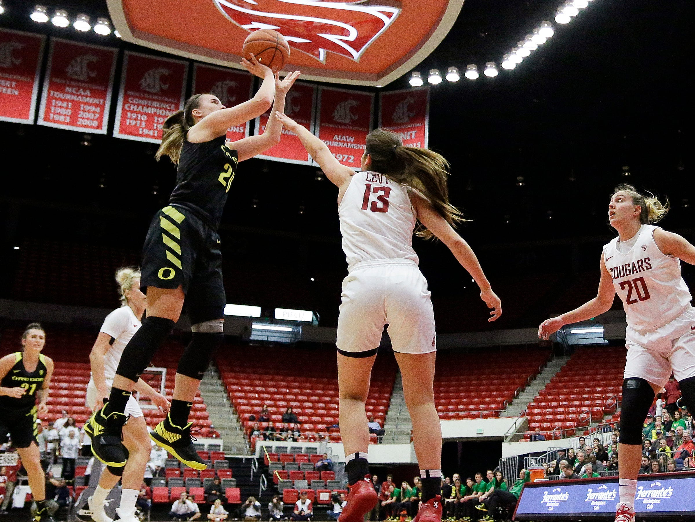 Oregon guard Sabrina Ionescu, front left, shoots over Washington State forward Shir Levy (13) during the first half of an NCAA college basketball game in Pullman, Wash., Friday, Jan. 25, 2019.