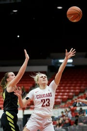 Washington State guard Alexys Swedlund (23) shoots while defended by Oregon guard Sabrina Ionescu during the first half of an NCAA college basketball game in Pullman, Wash., Friday, Jan. 25, 2019.
