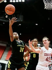 Oregon forward Ruthy Hebard (24) and Washington State forward Borislava Hristova (45) go after a rebound during the first half of an NCAA college basketball game in Pullman, Wash., Friday, Jan. 25, 2019.