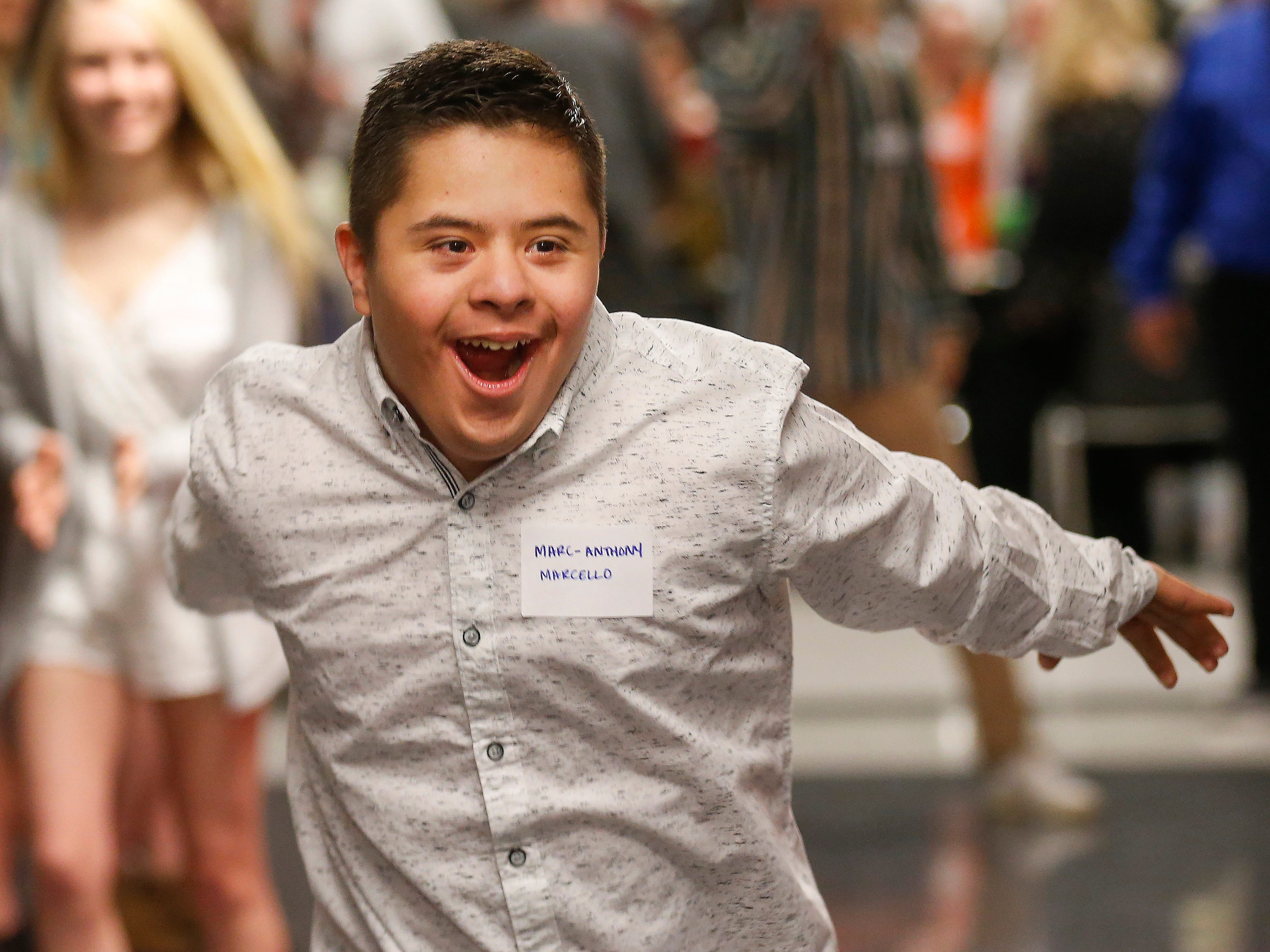 Marc-Anthony Marcello laughs as he runs down the red carpet at the Camp Barnabas Snow Ball at Springfield Catholic High School on Saturday, Jan. 26, 2019.